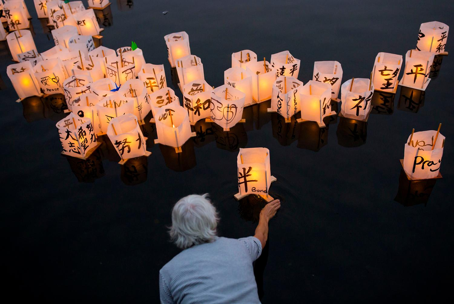Over 1,000 candle-lit lanterns carrying messages of peace and hope floated across Green Lake during From Hiroshima To Hope, a commemorative ceremony that marks the 72nd anniversary of the atomic bombings of Hiroshima and Nagasaki. (Sy Bean / Seattle Refined)