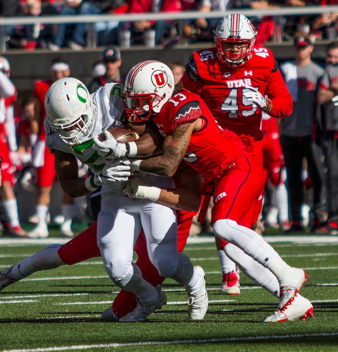 Utah Utes Jordan Fogal (#13) tackles Oregon Ducks Royce Freeman (#21). The Oregon Ducks beat the Utah Utes 30-28 on Saturday afternoon in Salt Lake City, UT at Rice-Ecce Stadium. Photo by Katie Pietzold