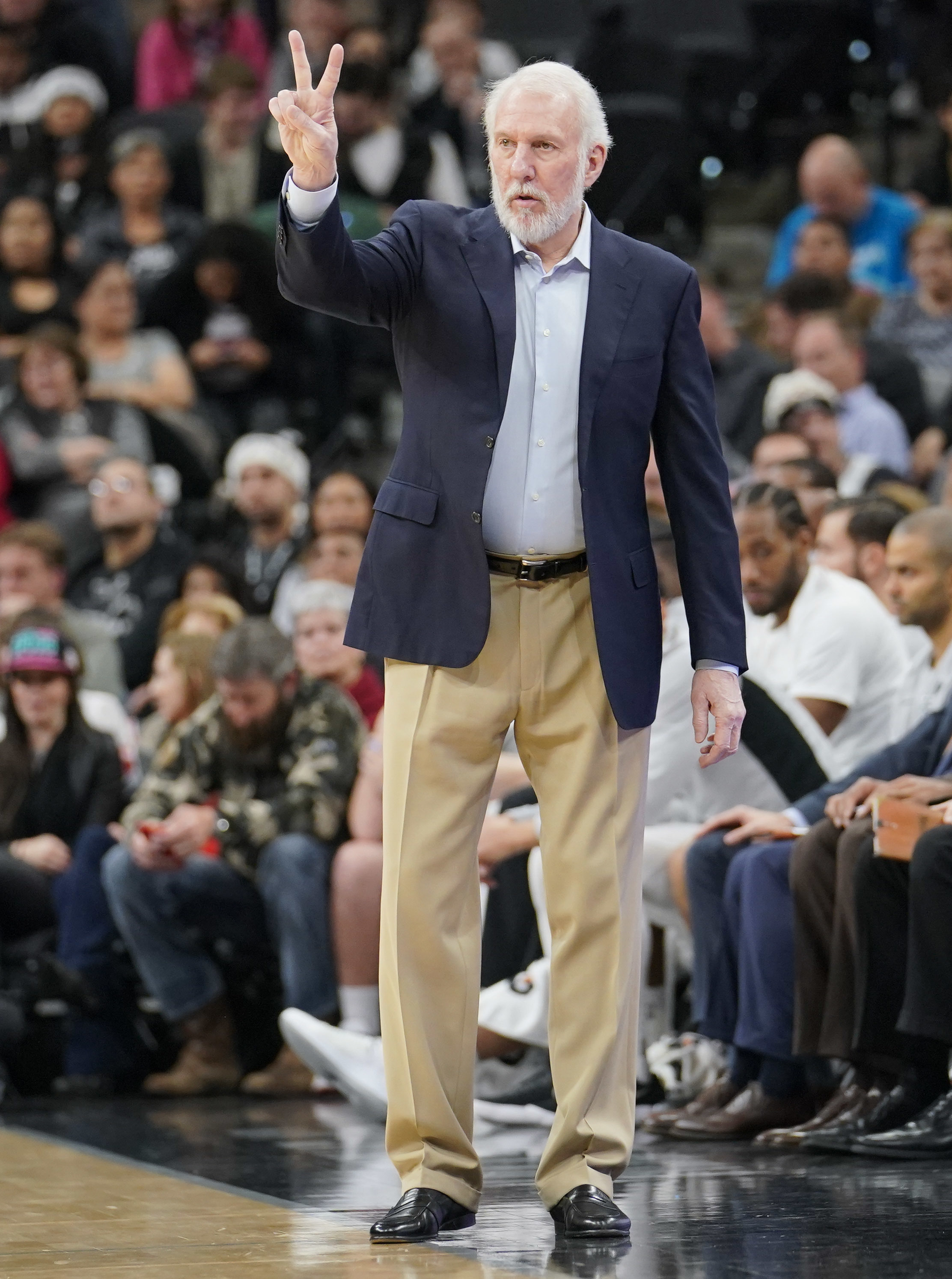 San Antonio Spurs head coach Gregg Popovich signals to his players during the first half of an NBA basketball game against the Los Angeles Clippers, Monday, Dec. 18, 2017, in San Antonio. (AP Photo/Darren Abate)