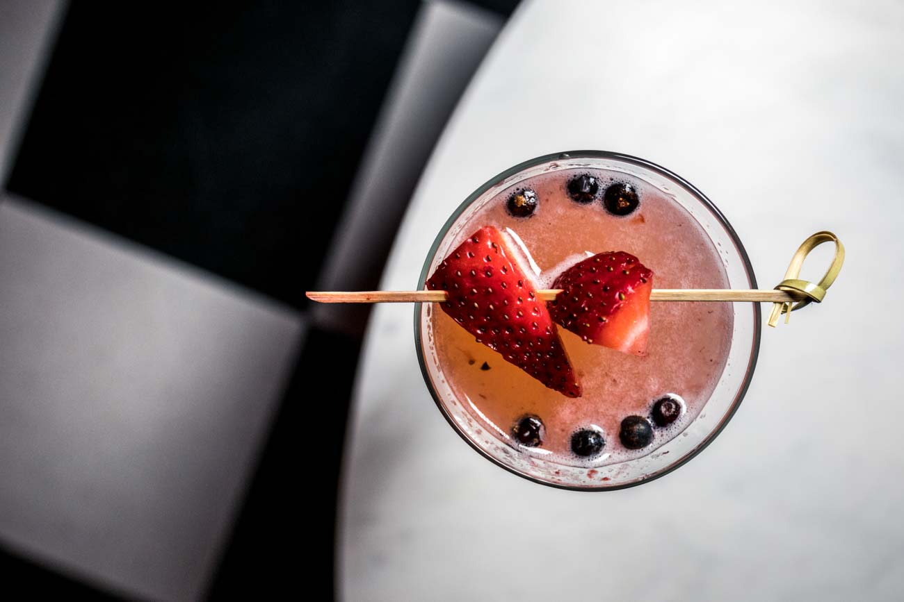 Berry Bubbly: muddled strawberry, lemon juice, simple, Cointreu, Absolute Citron, and champagne / Image: Catherine Viox // Published: 10.31.20