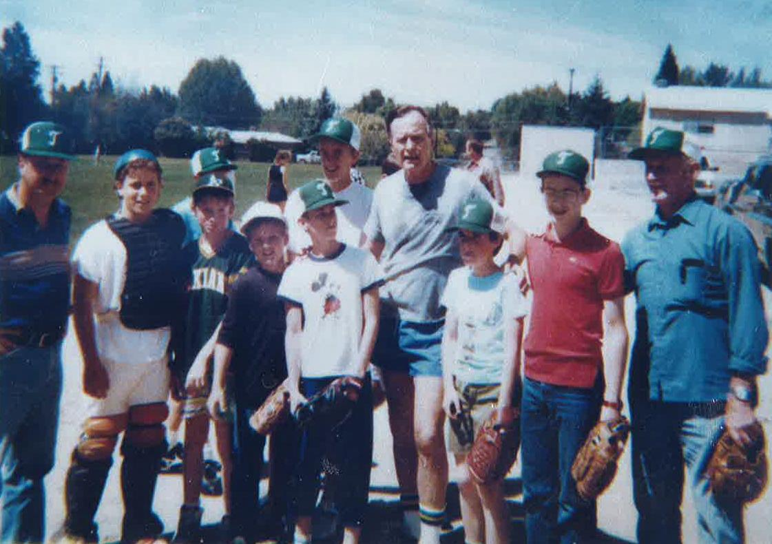 George H.W. Bush, pictured in gray in the center, visited with a Little League team coached by Gary Ames, far left, during a trip to Medford in 1988. Bush was four months away from being elected the 41st U.S. president when the photo was taken.