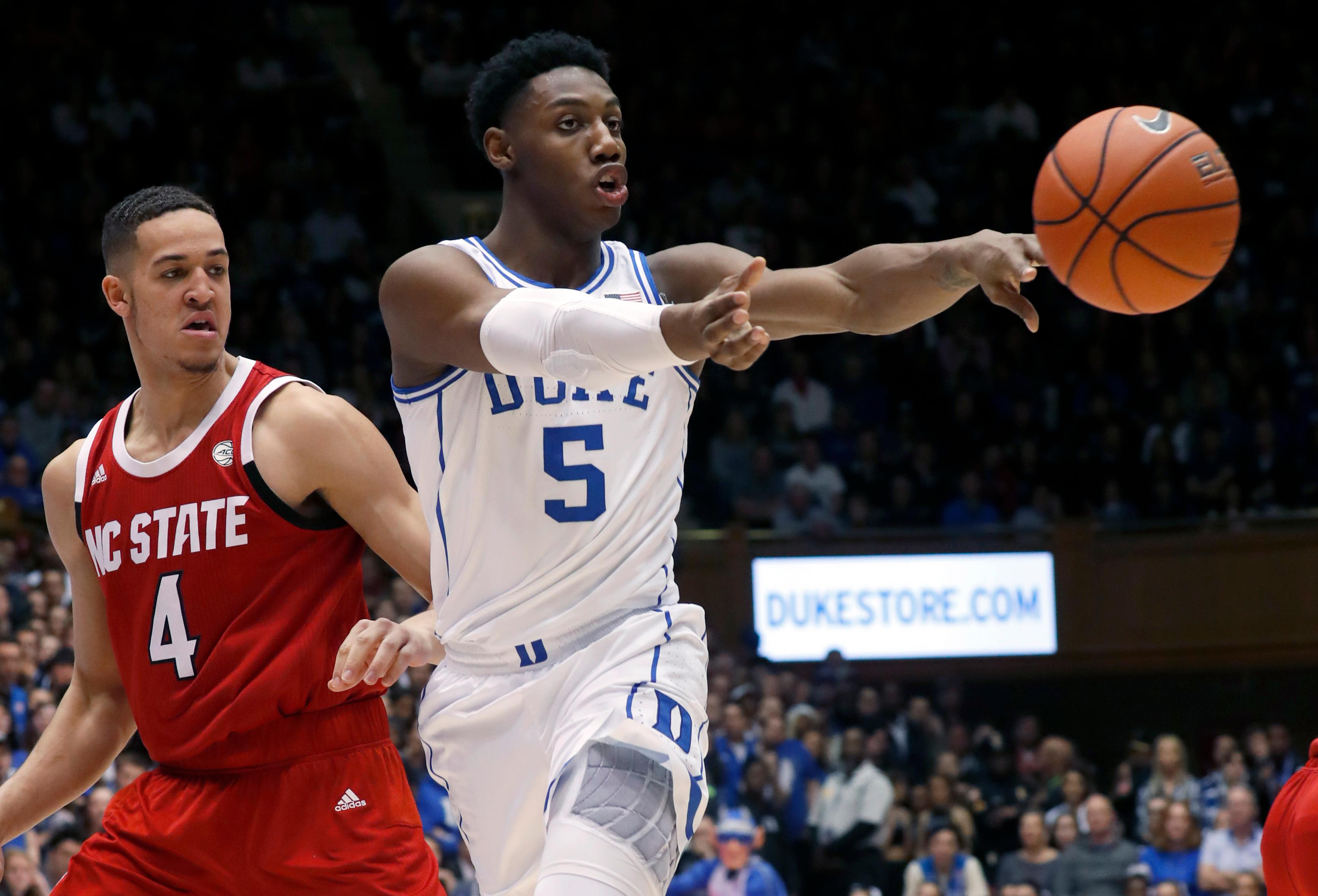 File-This Feb. 16, 2019, file photo shows Duke's RJ Barrett (5) passing the ball against North Carolina State's Jericole Hellems (4) during the second half of an NCAA college basketball game in Durham, N.C. Barrett leads the Atlantic Coast Conference in scoring. He just recorded Duke's first triple-double in 13 years. And as long as his roommate Zion Williamson is still around, he won't have top-billing for the top-ranked Blue Devils.That's just fine with Barrett. (AP Photo/Chris Seward, File)