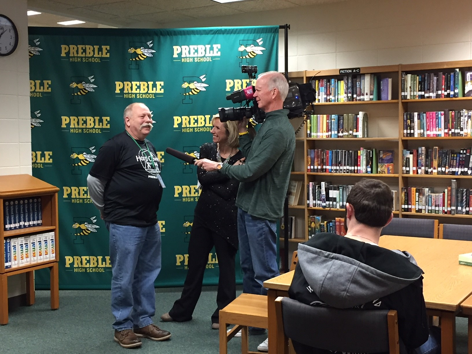 Larry Laraby, an alternative education teacher at Green Bay Preble High School, is interviewed by FOX 11's Michelle Melby Feb. 7, 2018, after being announced as a Golden Apple Award recipient. (WLUK/Donna Fischer)