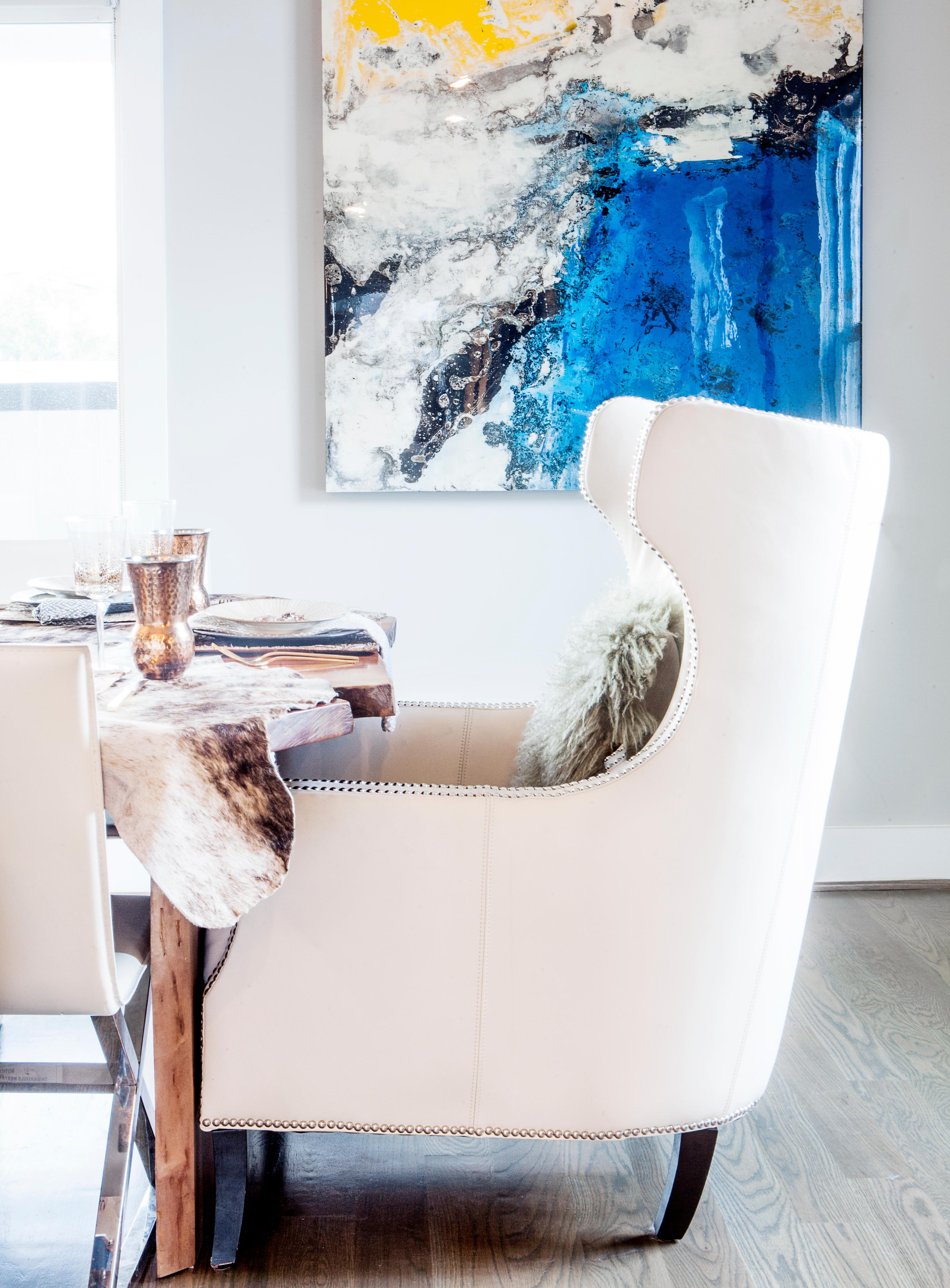 Statement seating really adds an extra element to a table. Get creative with your seating and find interesting chairs from around your home to place at the ends of the table. Here, I used wingback leather chairs from my living room for the guests of honor. (Image: Ashley Hafstead)