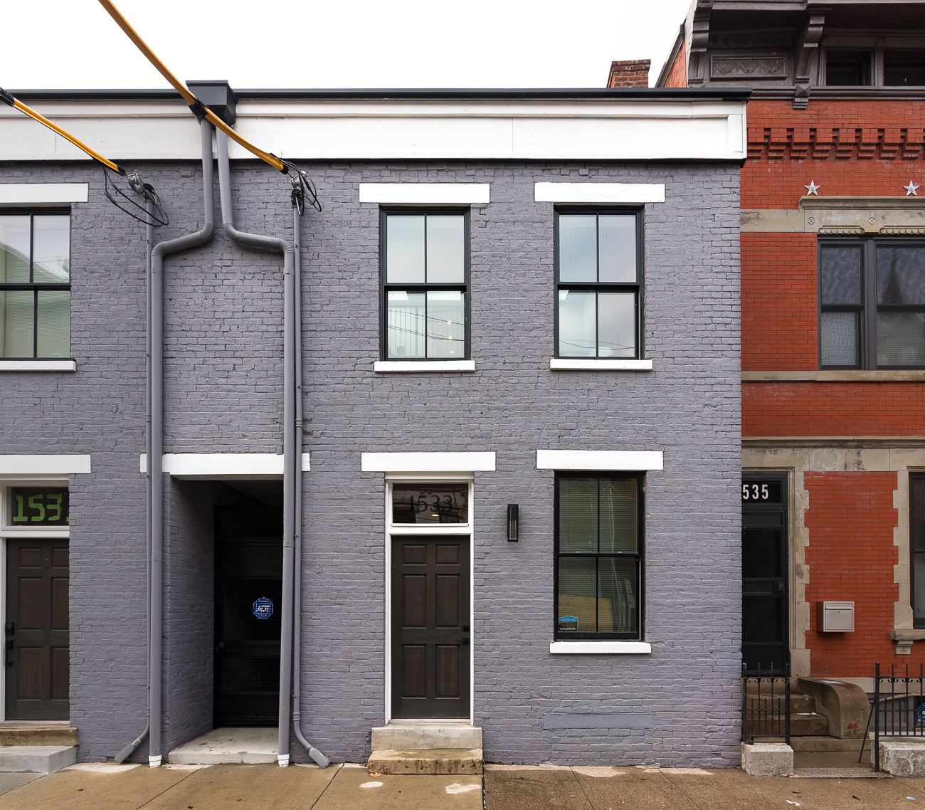 You know where Republic Street meets Liberty Street in Over-the-Rhine? Just south of that intersection is a grey single-family home that seems modest from the sidewalk, but inside you'll find a new home that's anything but. / Image: Phil Armstrong, Cincinnati Refined // Published: 2.4.19