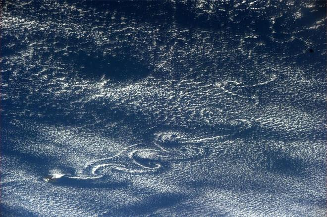 Island off of Central America makes some interesting cloud formations (Photo & Caption courtesy Rick Mastracchio (@AstroRM) and NASA)