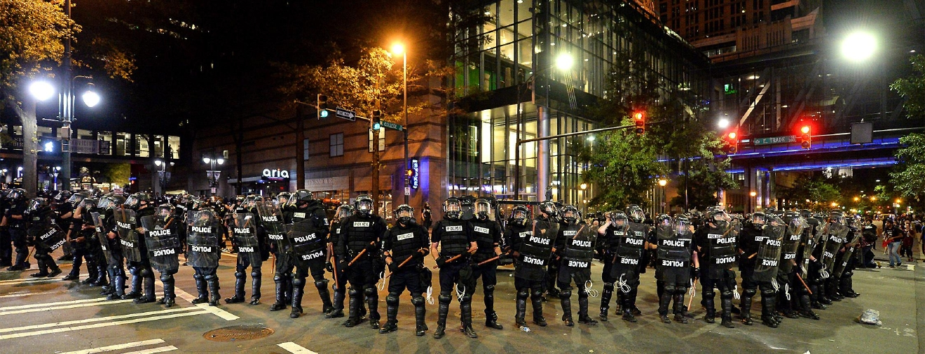 CMPD officers in riot gear block the intersection near the Epicentre in Charlotte, N.C. Wednesday, Sept. 21, 2016.   (Jeff Siner/The Charlotte Observer via AP)