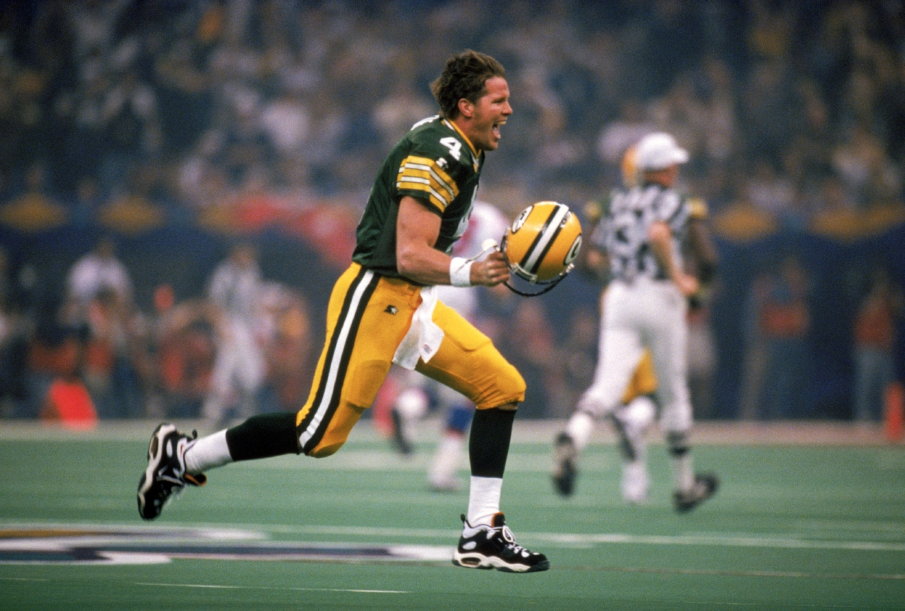 Green Bay Packers quarterback Brett Favre celebrates his first-quarter touchdown pass to wide receiver Andre Rison in Super Bowl XXXI at the Louisiana Superdome on Jan. 26, 1997. in New Orleans. The Packers beat the New England Patriots, 35-21.  (Photo by Andy Hayt/Getty Images)
