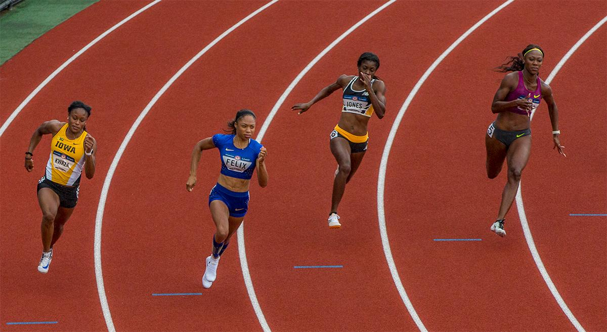 Nike's Allyson Felix races around the corner in the 200 meters. Felix finished fifth overall with a time of 22.93. Photo by August Frank, Oregon News Lab