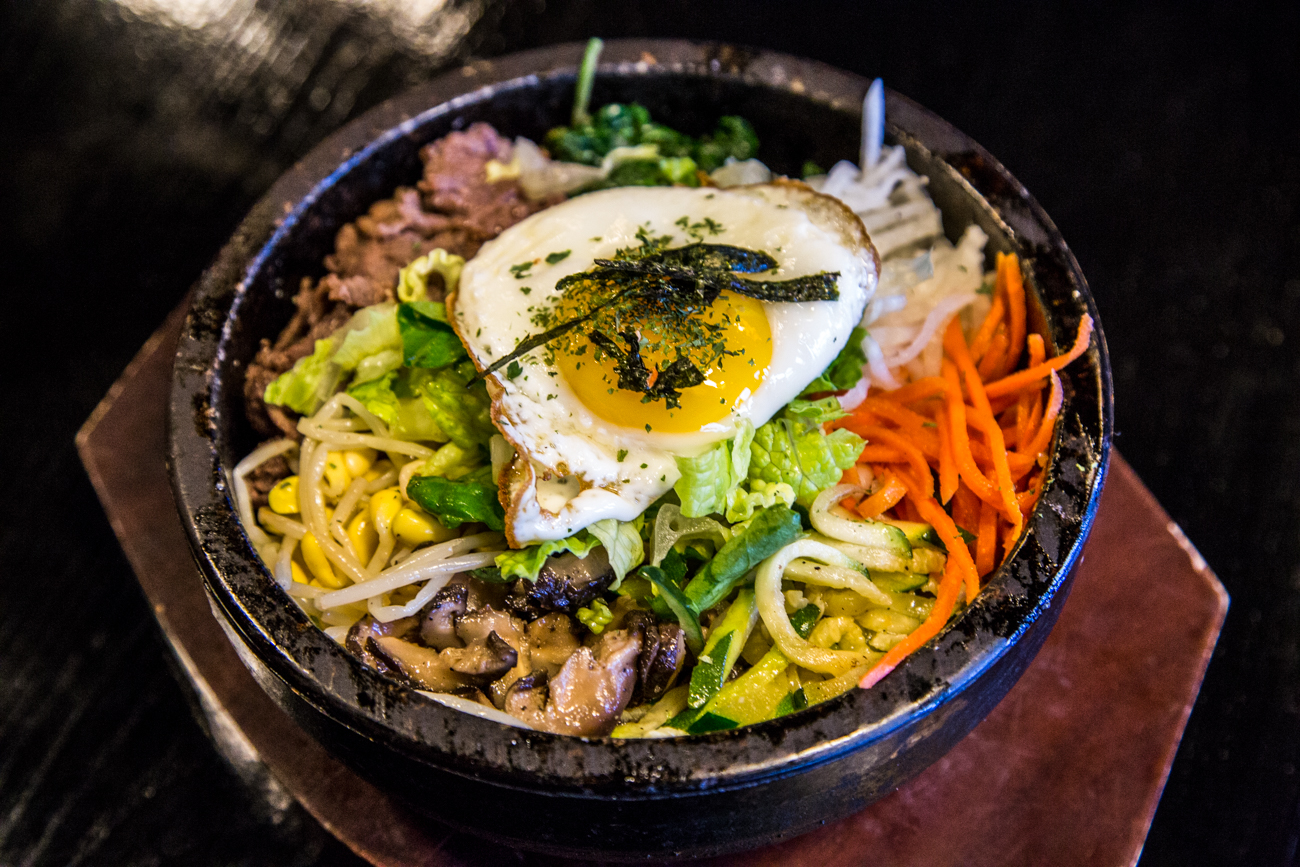 Dolsot Bibimbap with Beef: steamed rice topped with assorted vegetables, topped with a fried egg with hot sauce on the side in a Vega Sindoa Merlot sauce / Image: Catherine Viox // Published: 1.31.17