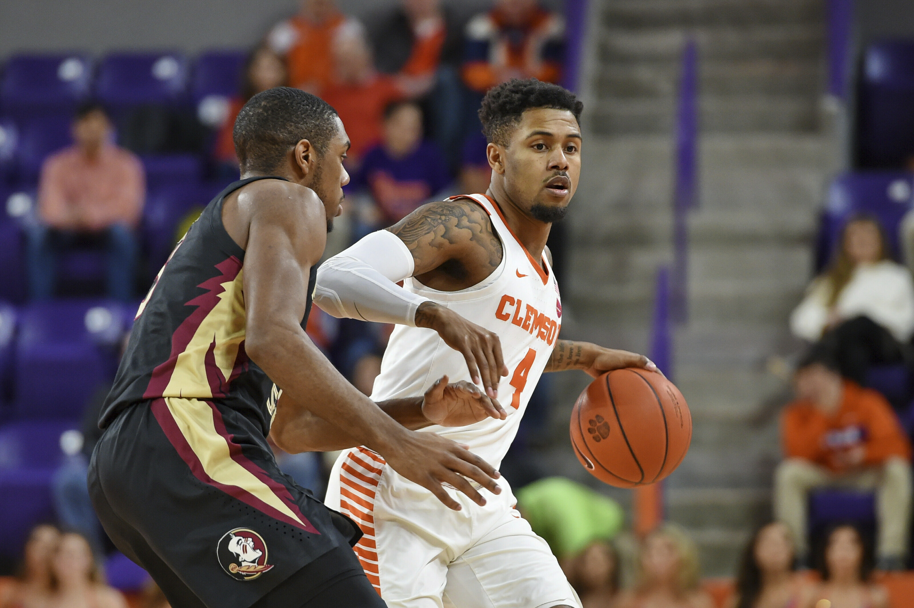 Clemson's Shelton Mitchell, right, drives against Florida State's Trent Forrest, left, during the first half of an NCAA college basketball game Tuesday, Feb. 19, 2019, in Clemson, S.C. (AP Photo/Richard Shiro)