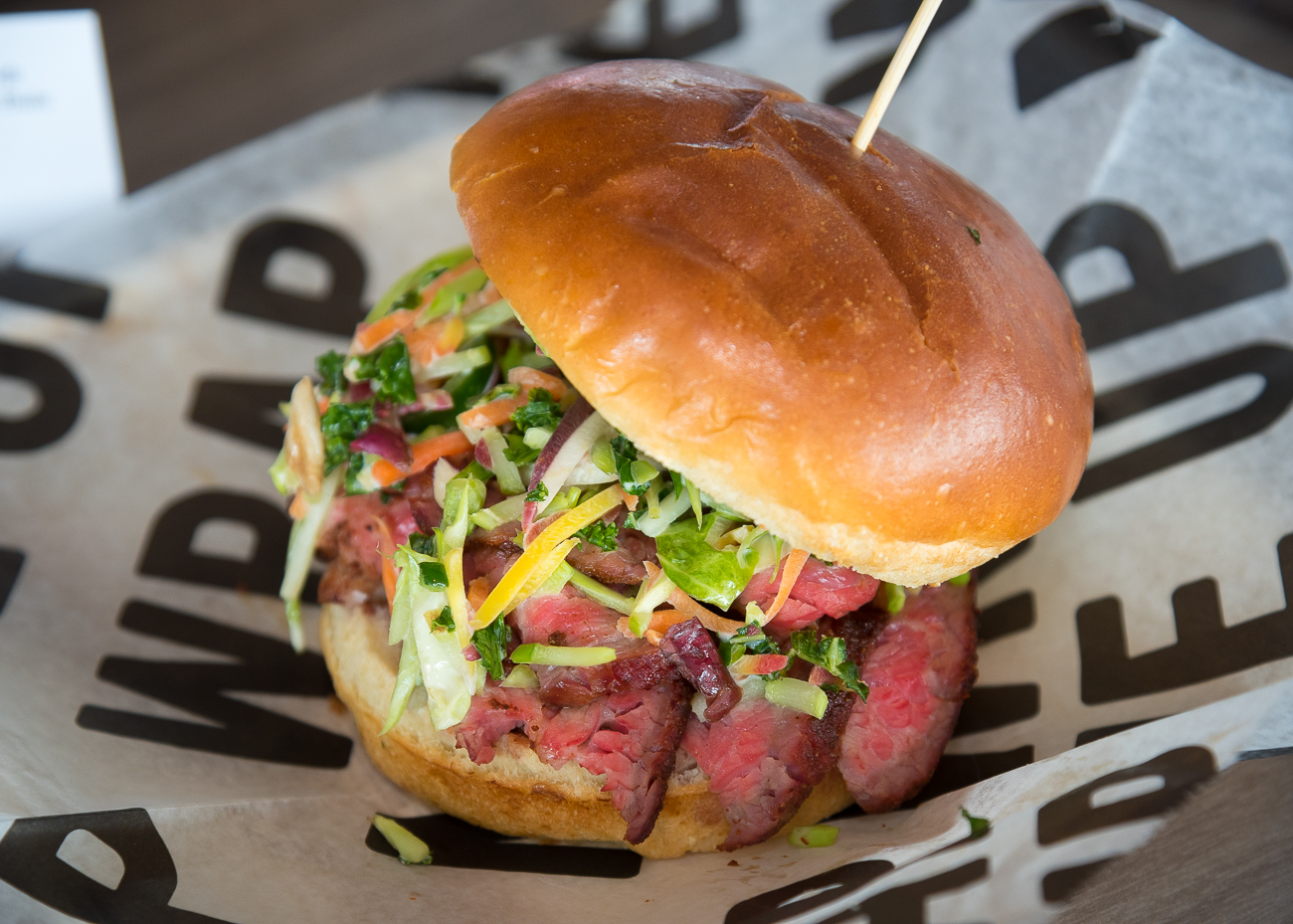 Smoked Tri-Tip: House-smoked sirloin topped with jalapeno slaw and served on a brioche bun (available at Mr. Red's Smokehouse—section 137) / Image: Phil Armstrong, Cincinnati Refined // Published: 3.21.19