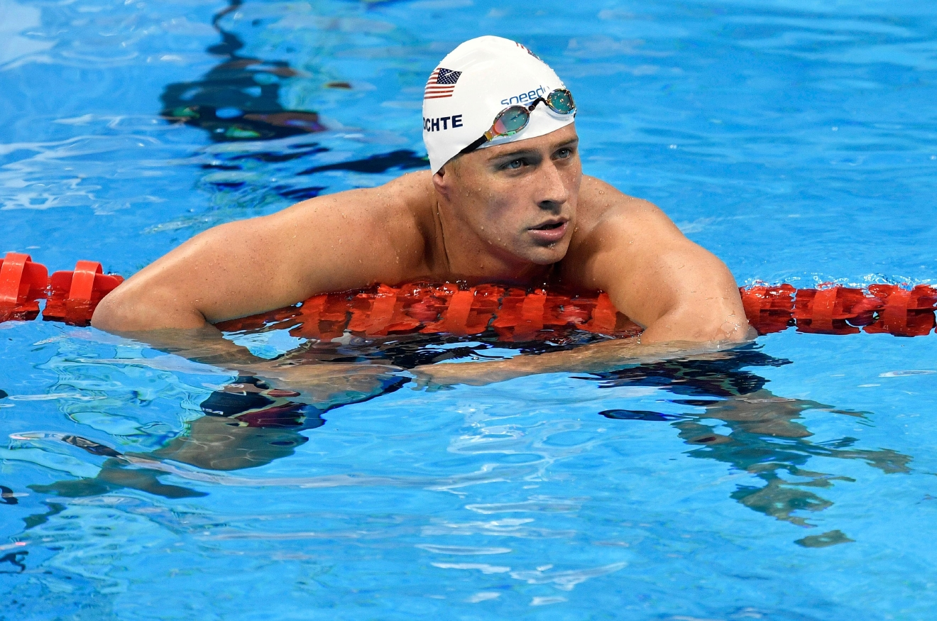 FILE - In this Aug. 9, 2016, file photo, United States' Ryan Lochte checks his time after a men' 4x200-meter freestyle relay heat during the swimming competitions at the 2016 Summer Olympics in Rio de Janeiro, Brazil. (AP Photo/Martin Meissner, File)