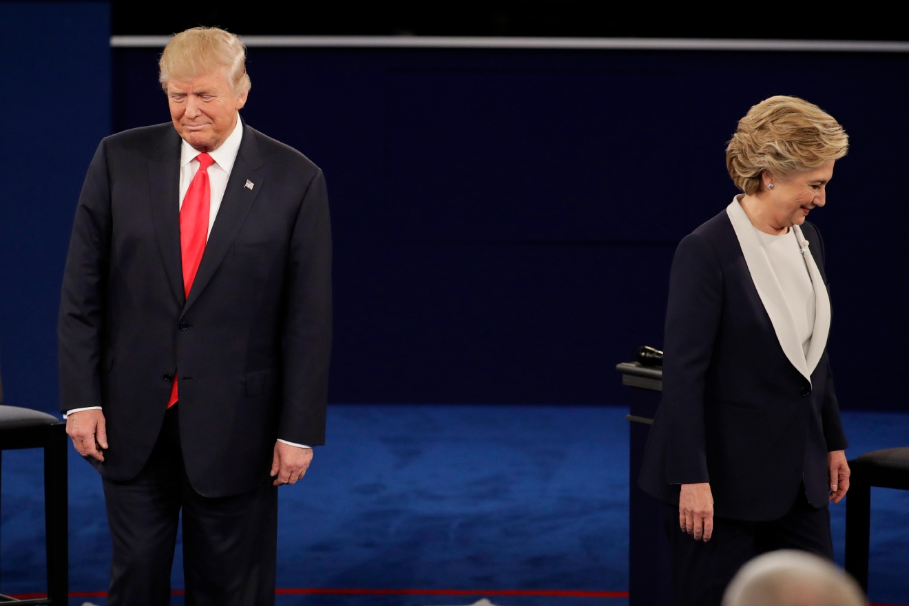 Republican presidential nominee Donald Trump and Democratic presidential nominee Hillary Clinton walk to their positions during the second presidential debate at Washington University in St. Louis, Sunday, Oct. 9, 2016. (AP Photo/Julio Cortez)