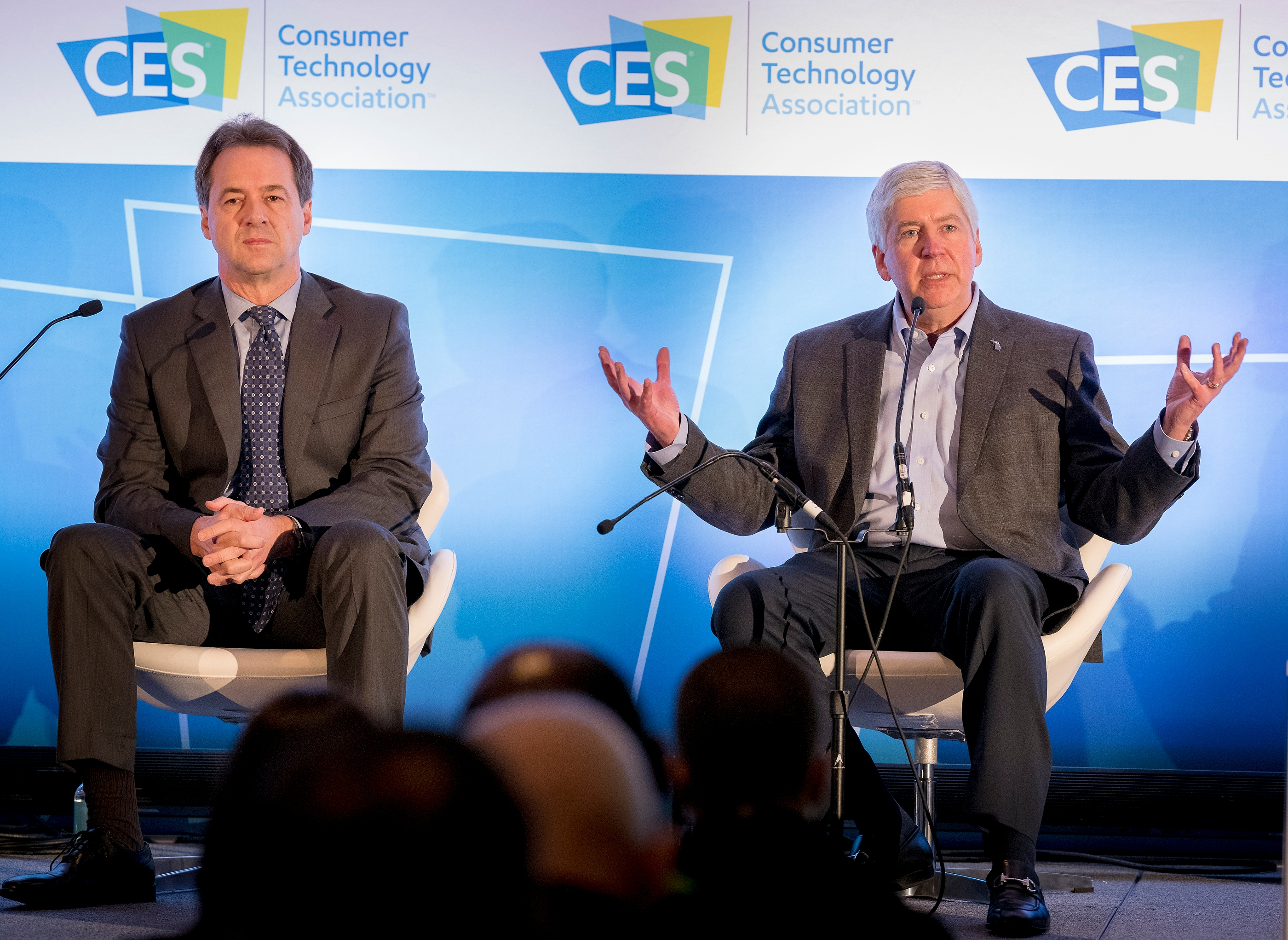 "Montana Governor Steve Bullock, left, and Michigan Governor Rick Snyder participate in a panel discussion ""How States Can Become Innovation Leaders""  during CES at the Las Vegas Convention Center on Thursday, Jan. 11, 2018. CREDIT: Mark Damon/Las Vegas News Bureau"