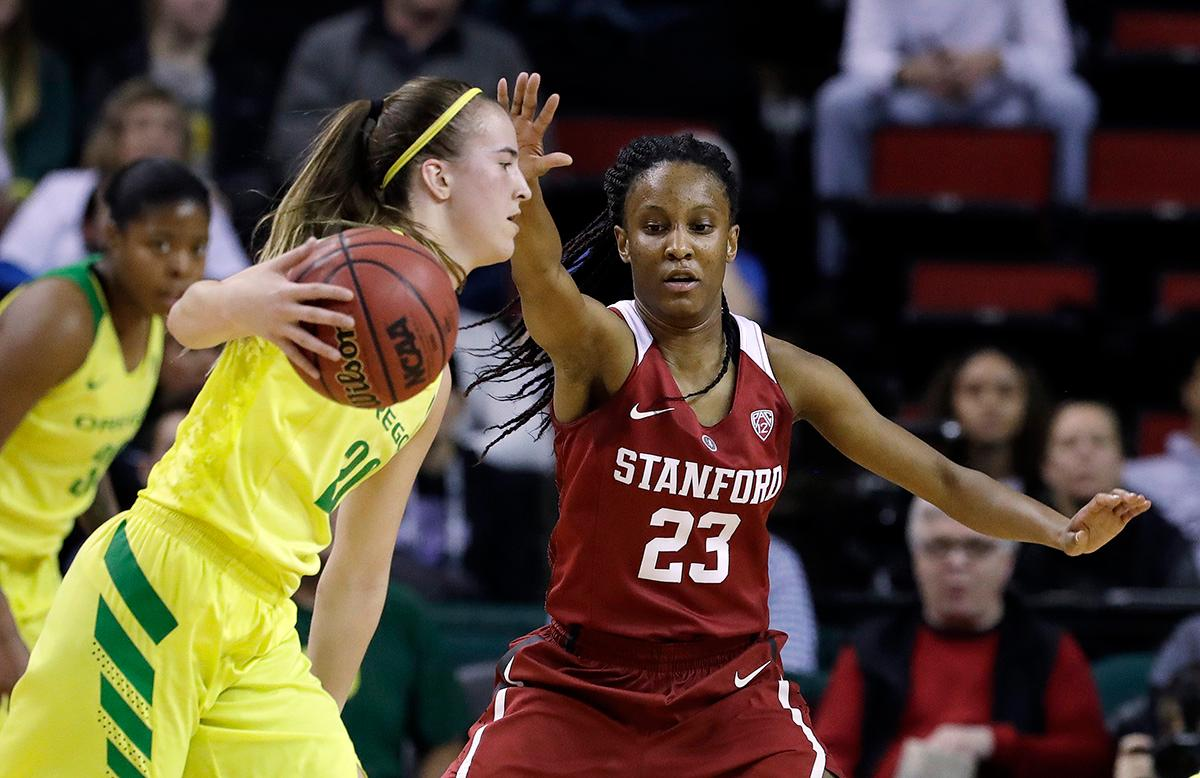 Stanford's Kiana Williams (23) defends Oregon's Sabrina Ionescu during the first half of an NCAA college basketball game in the finals of the Pac-12 Conference women's tournament, Sunday, March 4, 2018, in Seattle. (AP Photo/Elaine Thompson)