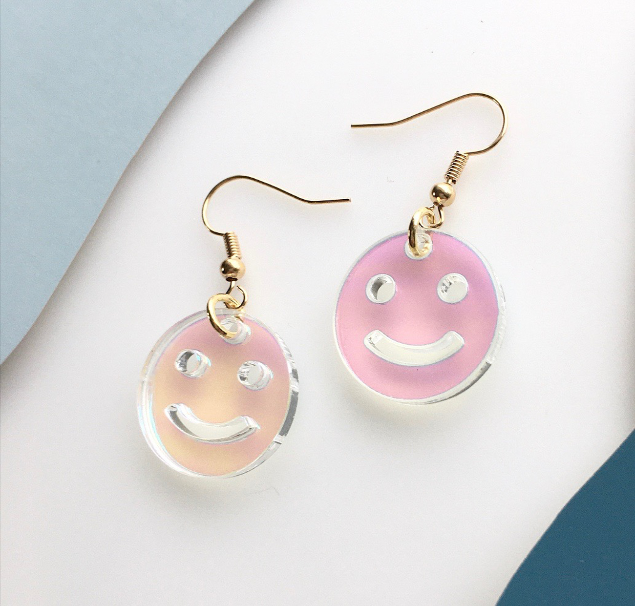 Iridescent laser-cut smiley face earrings{&nbsp;}/ Image: courtesy of Ellebrux // Published: 3.26.20{&nbsp;}<br><p></p>