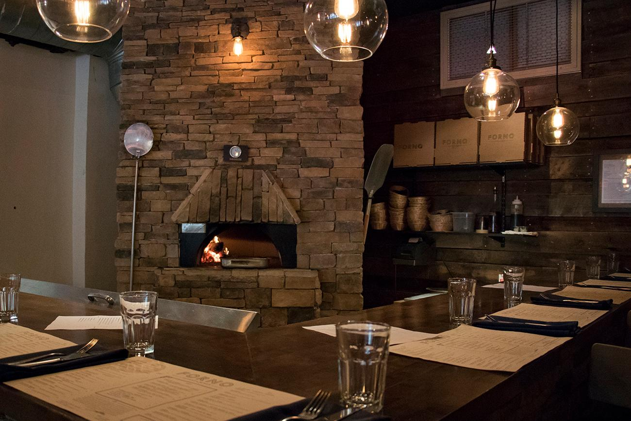 <p>&quot;Forno&quot; is Italian for oven. The wood-burning oven in the restaurant acts as the room's centerpiece. / Image: Allison McAdams // Published: 9.8.18</p>