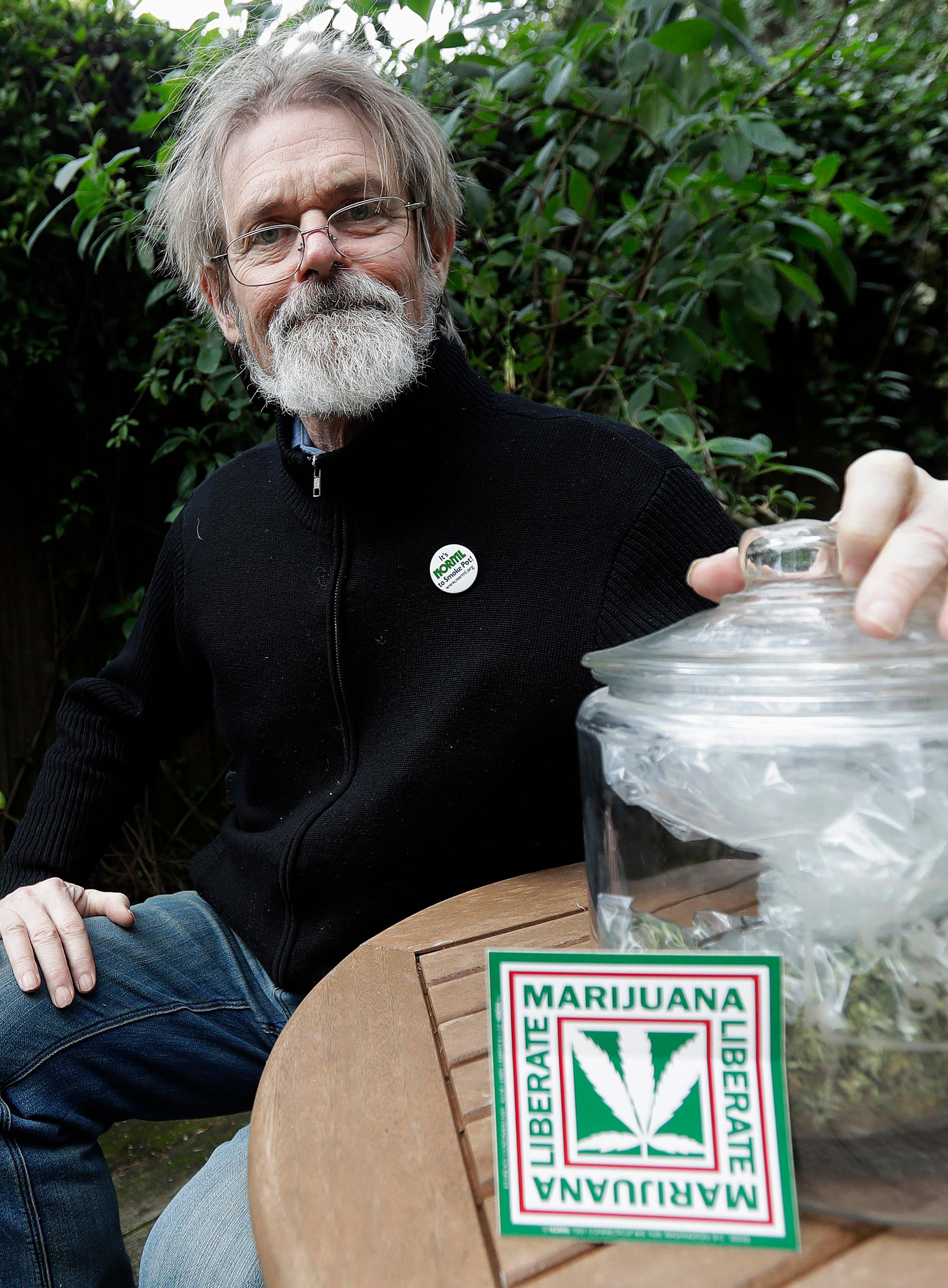 In this Dec. 22, 2017 photo, Dale Gieringer of NORML (National Organization for the Reform of Marijuana Laws) poses for photos at his house in Berkeley, Calif. Californians may awake on New Year's Day to a familiar scent in greater-than-normal concentrations. A whiff of marijuana will likely be in the air as the nation's cannabis king lights up to celebrate the first legal retail sales of pot in the state. (AP Photo/Jeff Chiu)