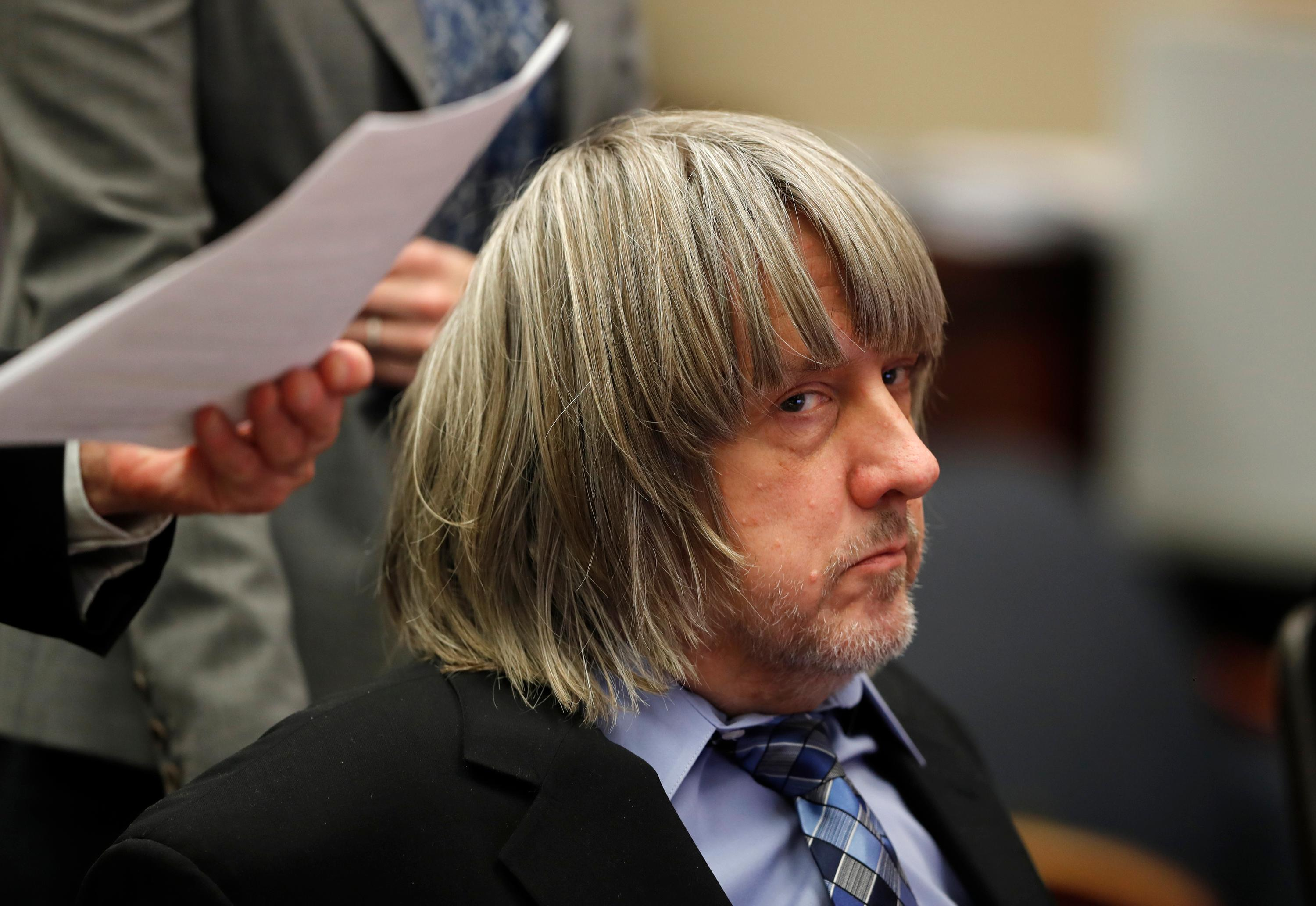 FILE - In this Jan. 24, 2018 file photo, David Turpin appears in court in Riverside, Calif. David and Louse Turpin, who are charged with torturing their children by starving, beating and shackling them, are scheduled to appear Friday, Feb. 23, 2018, in a Riverside courtroom for a conference about their case. (Mike Blake/Pool Photo via AP, File)