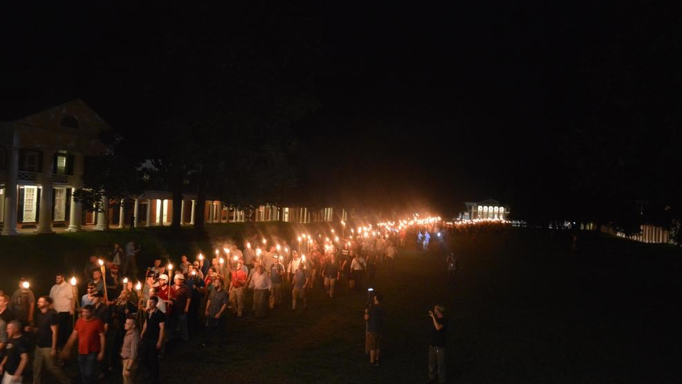 The white nationalists carrying torches on UVA's campus Friday night. (The Cavalier Daily)