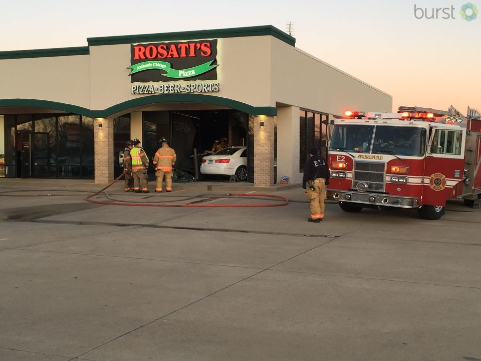 Officials are on the scene of Rosati's Pizza on 6th Street after a car ran through the front window. (Photo Courtesy of Photojournalist Andrew Campbell)