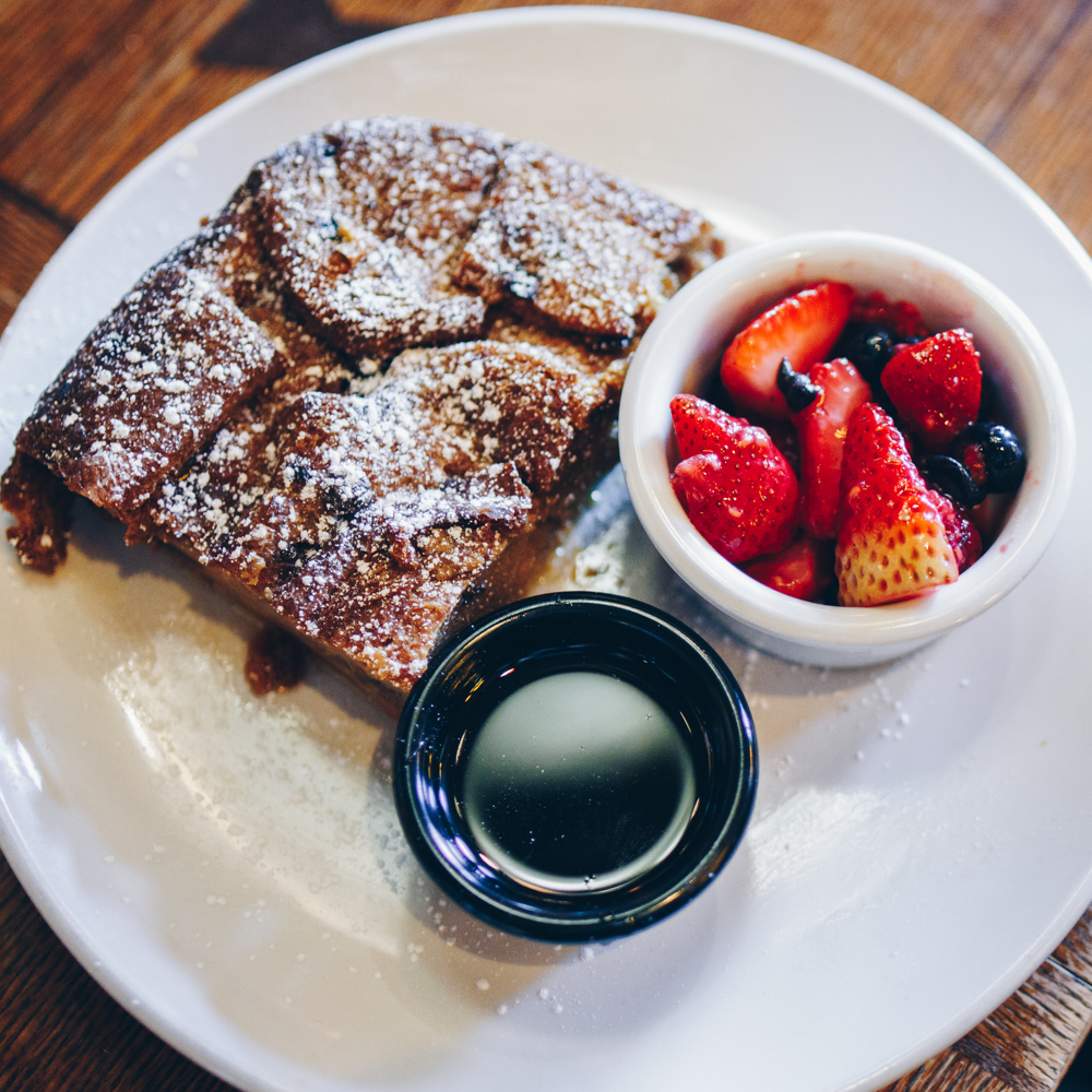 French Toast: cinnamon raisin bread, eggs and caramel, powdered sugar, maple bourbon syrup, and fresh seasonal fruit / Image: Catherine Viox // Published: 5.4.18