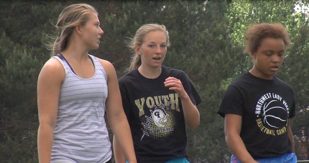 Girls from the Northwest (Grand Island) track and field team take a cool down walk during a practice on May 16, 2017 (NTV News)
