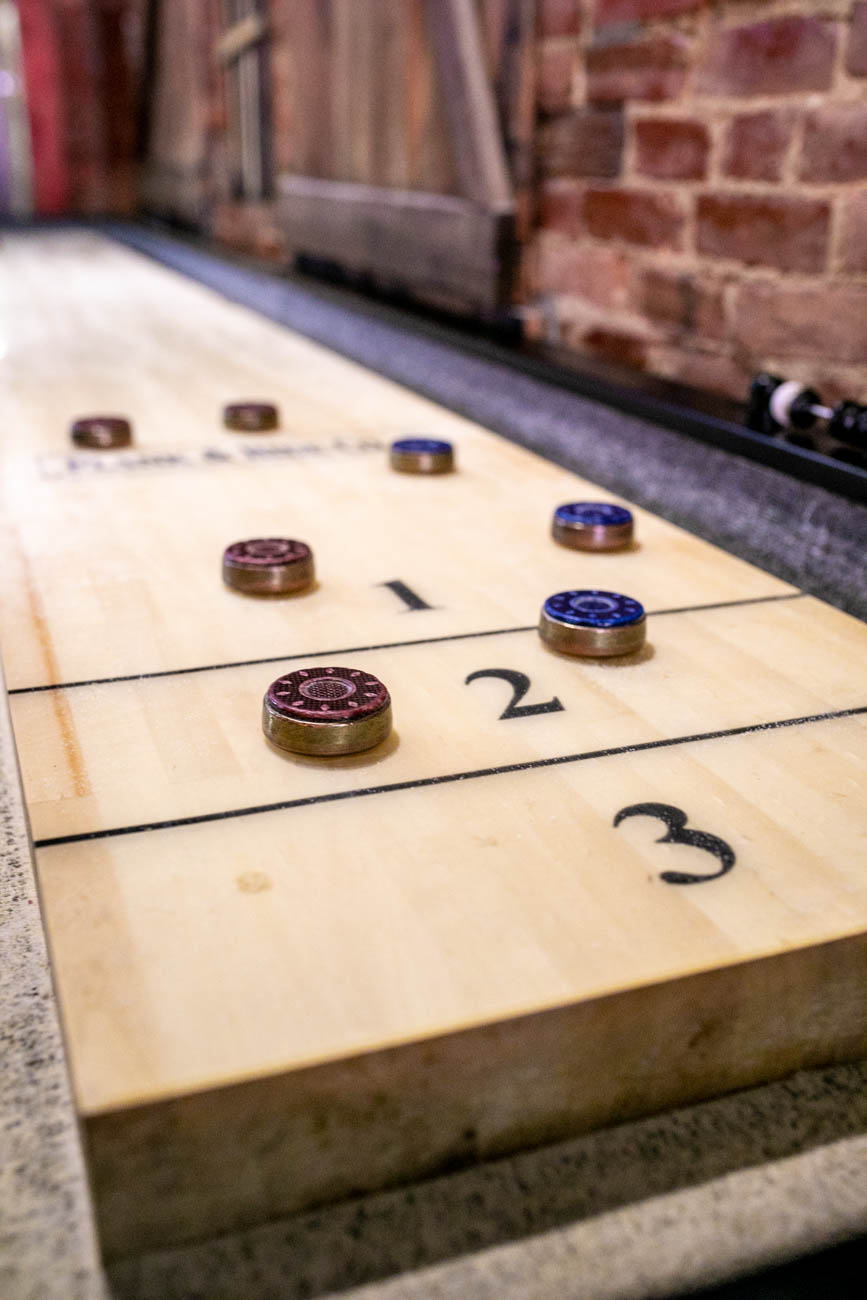 Tabletop shuffleboard is available to play in the front bar. / Image: Amy Elisabeth Spasoff // Published: 5.29.18