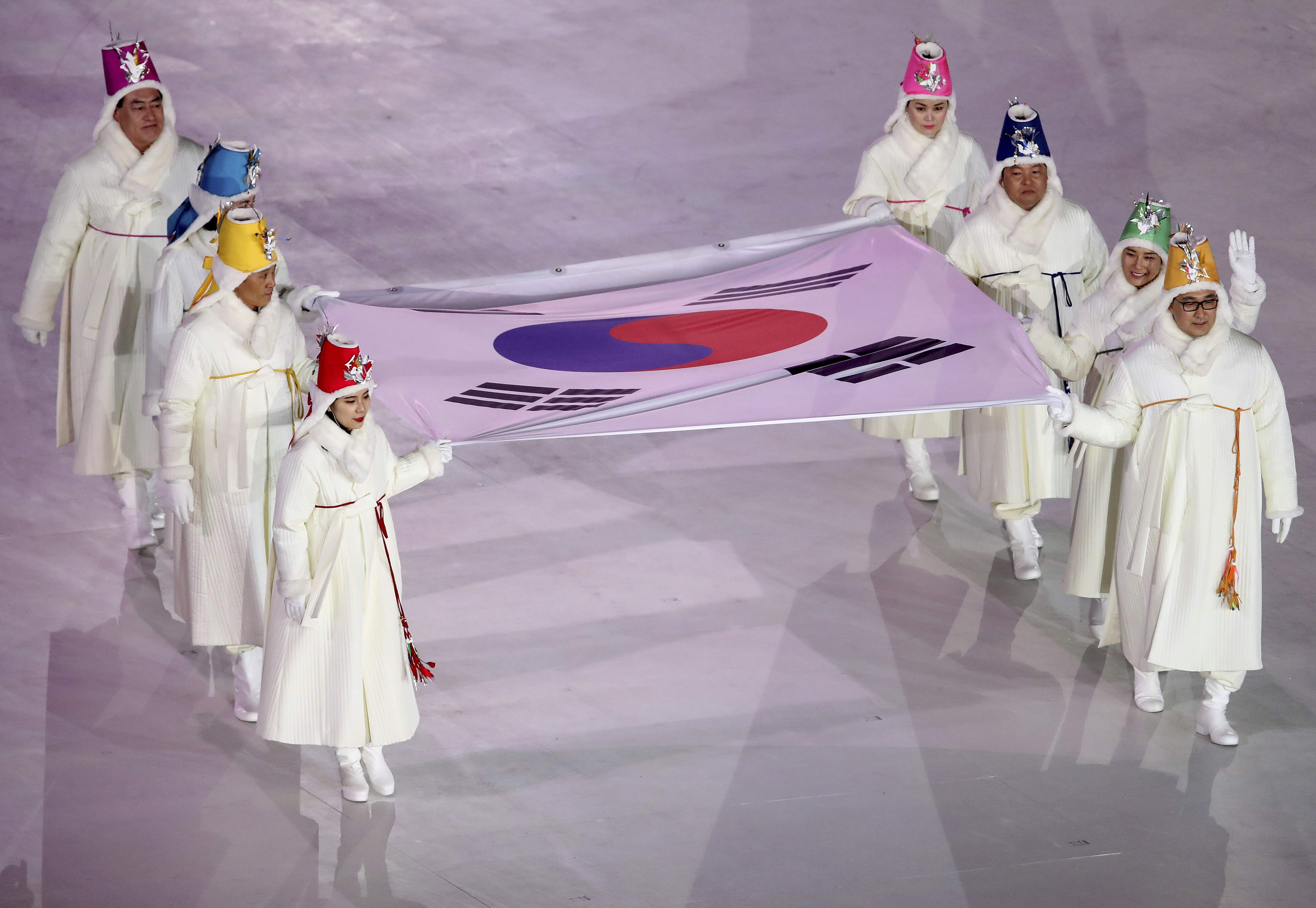 Former Olympians carry the Republic of Korea flag during the opening ceremony of the 2018 Winter Olympics in Pyeongchang, South Korea, Friday, Feb. 9, 2018. (Sean Haffey/Pool Photo via AP)