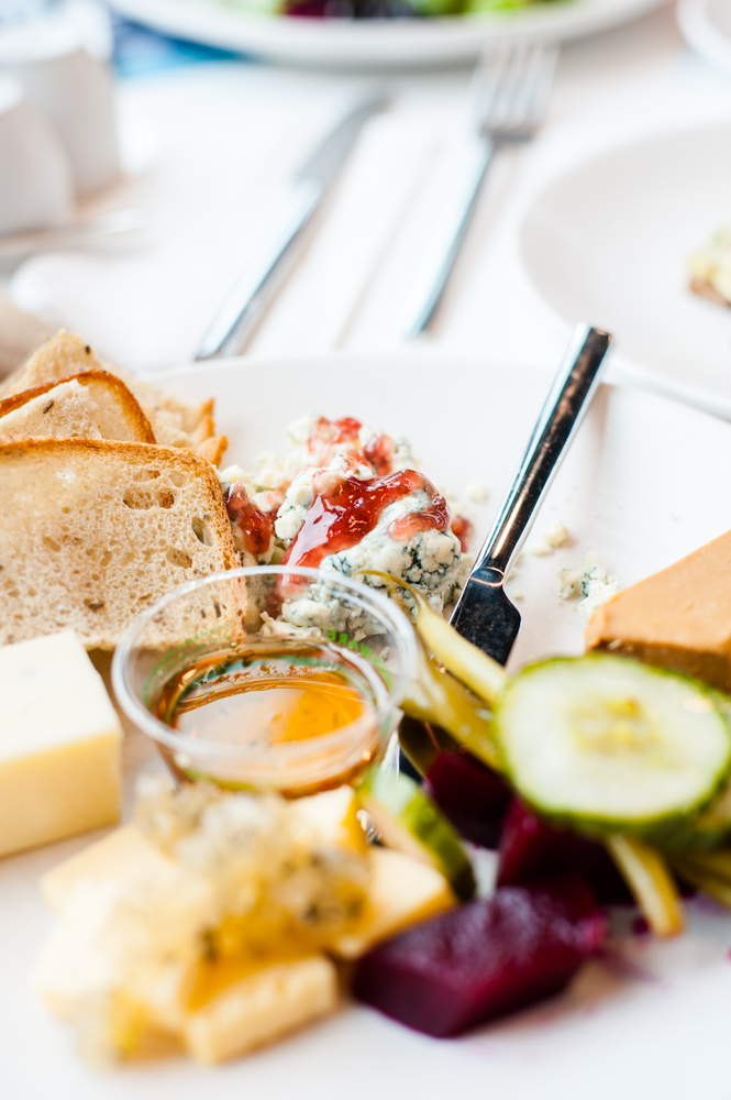The Ostebrett cheese board is comprised of several Scandinavian kinds of cheese as well as pickled vegetables and a delicious raspberry rose jam. (Image: Elizabeth Crook / Seattle Refined)