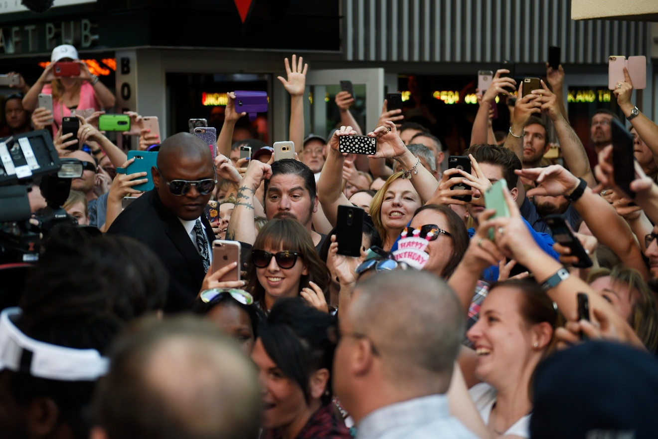 Fans strain to get a photo of Mark Wahlberg as he arrives at a VIP event at Wahlburgers Las Vegas in the Grand Bazaar Shops at Bally's Tuesday, March 28, 2017. [Sam Morris/Las Vegas News Bureau]