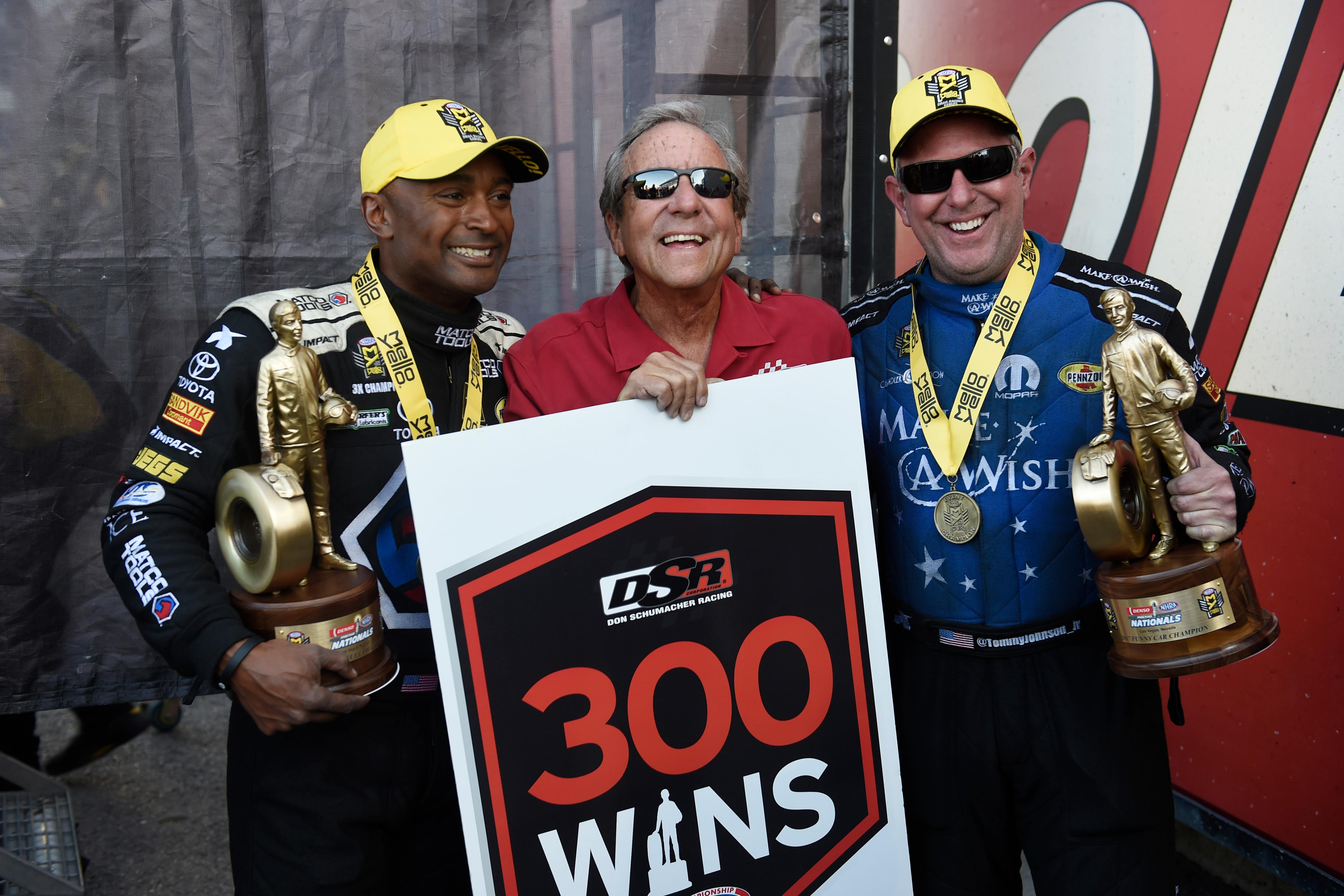 Top Fuel winner Antron Brown, left, and Funny Car winner Tommy Johnson Jr., right, pose for a photo with the owner of their teams Don Schumacher after giving Schumacher his 299th and 300th career victory during the NHRA DENSO Spark Plug Nationals at The Strip at the Las Vegas Motor Speedway Sunday, April 2, 2017. (Sam Morris/Las Vegas News Bureau)