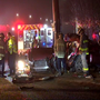 Firefighters cut woman out of car after she crashes into utility pole