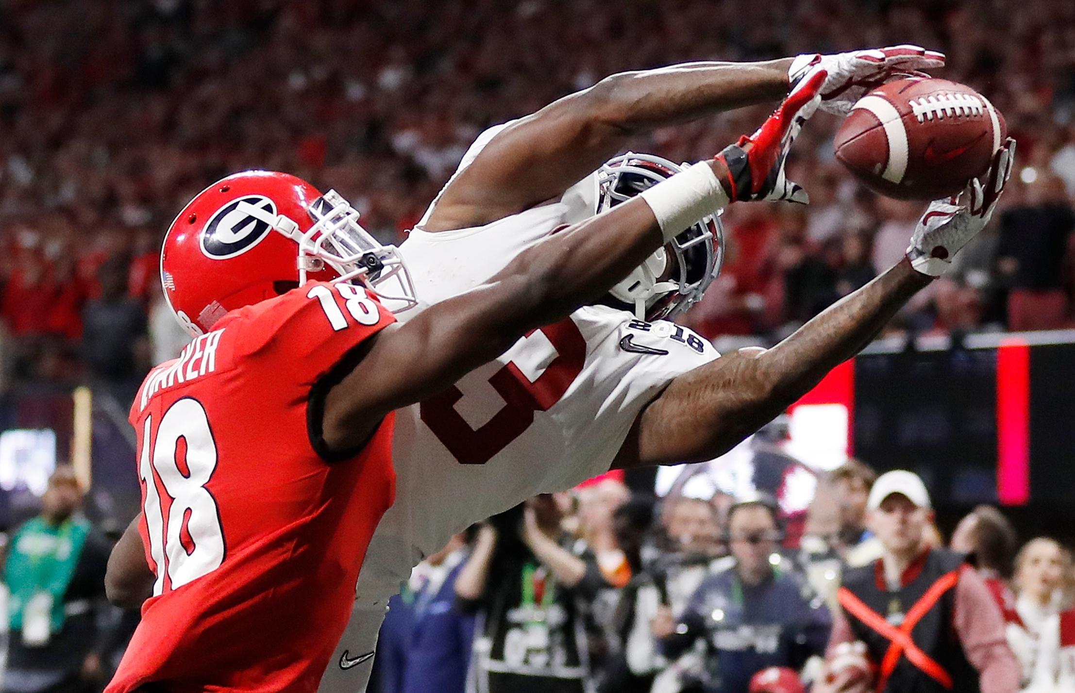 Georgia's Deandre Baker knocks the ball away from Alabama's Calvin Ridley during the second half of the NCAA college football playoff championship game Monday, Jan. 8, 2018, in Atlanta. (AP Photo/David Goldman)
