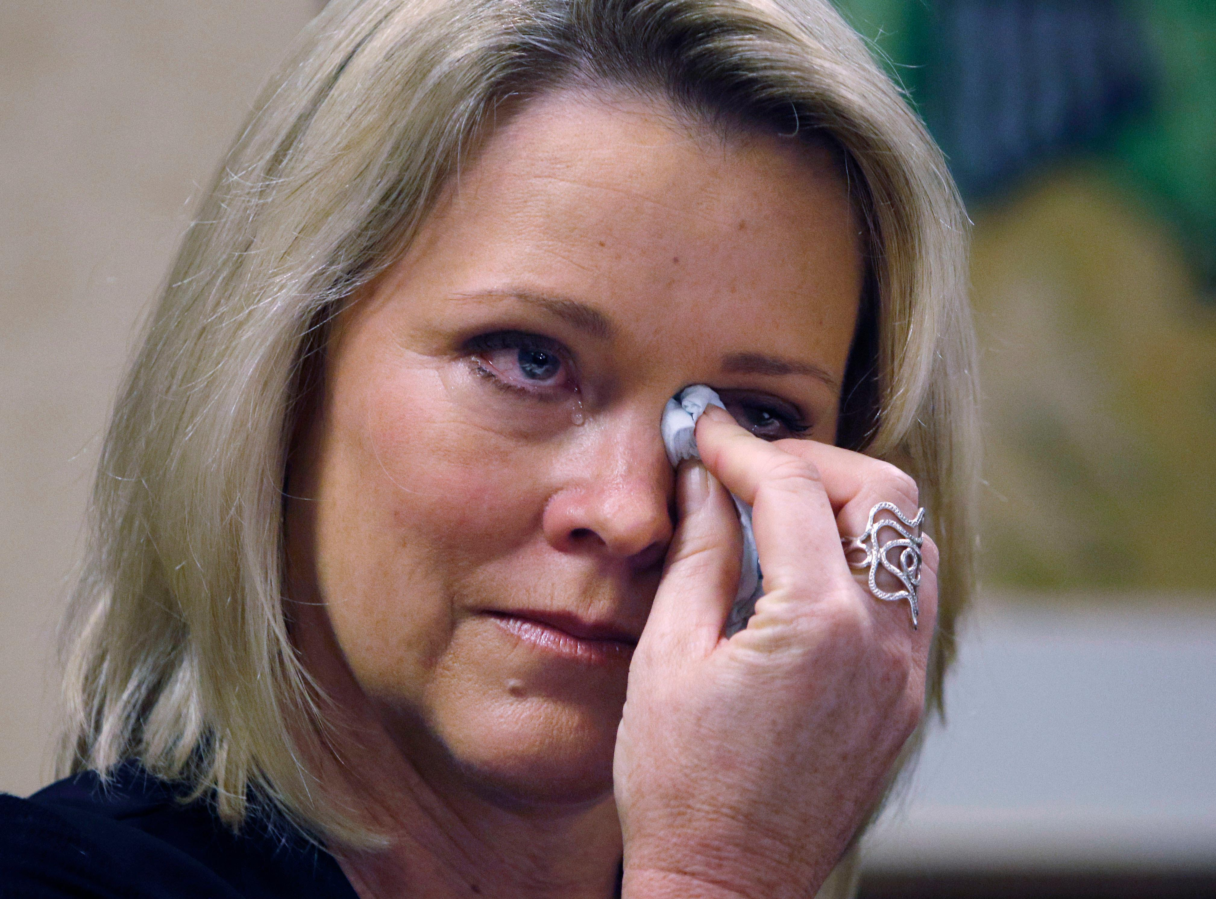 Former Boston television news anchor Heather Unruh wipes tears while speaking Wednesday, Nov. 8, 2017, in Boston, about the alleged sexual assault of her teenage son by actor Kevin Spacey in the summer of 2016 on Nantucket. (AP Photo/Bill Sikes)