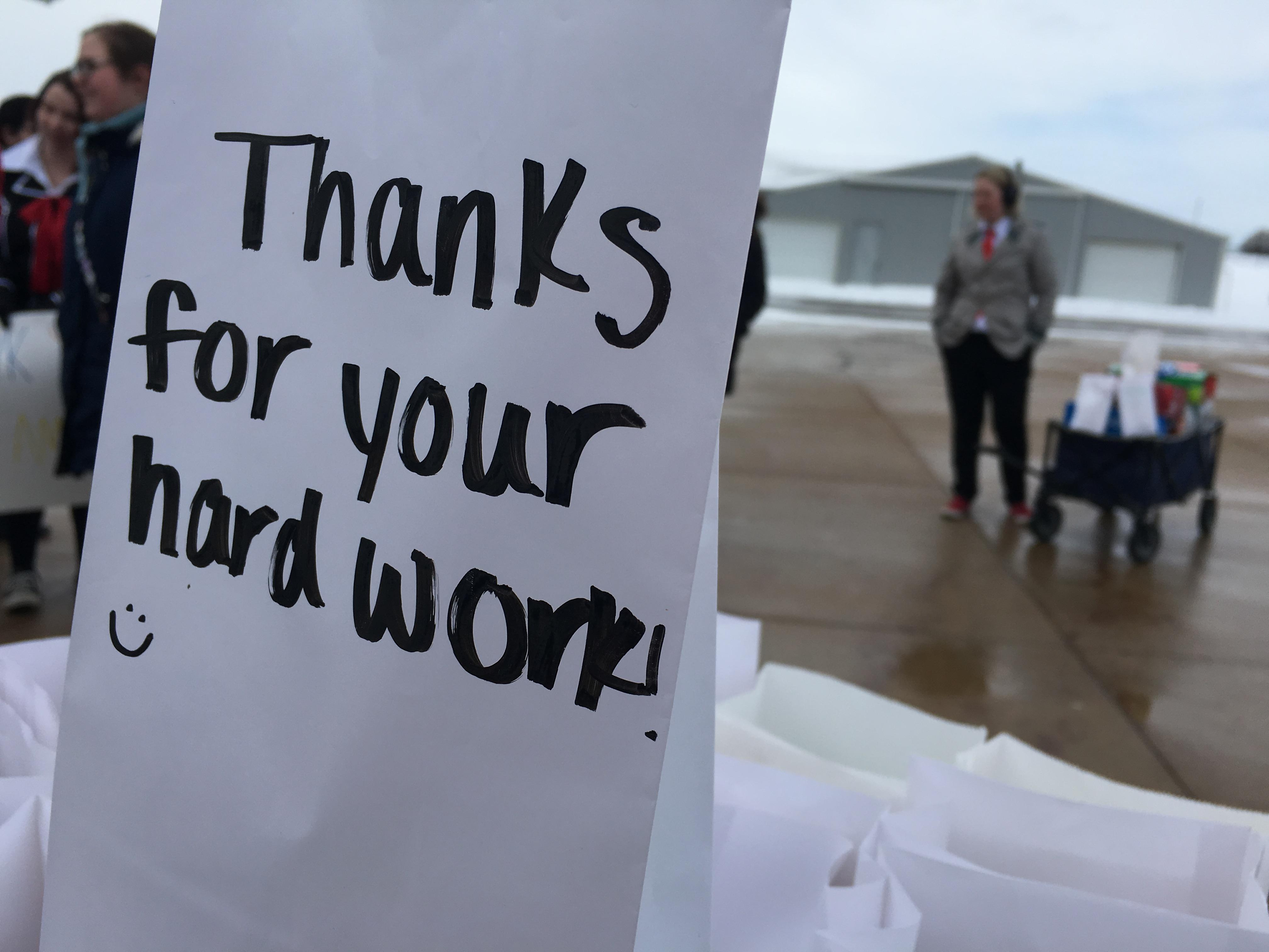 A bag of popcorn with some words of encouragement is ready to be handed out to service workers and first responders in the Thornapple Kellogg community.{ } (WWMT/Jason Heeres)