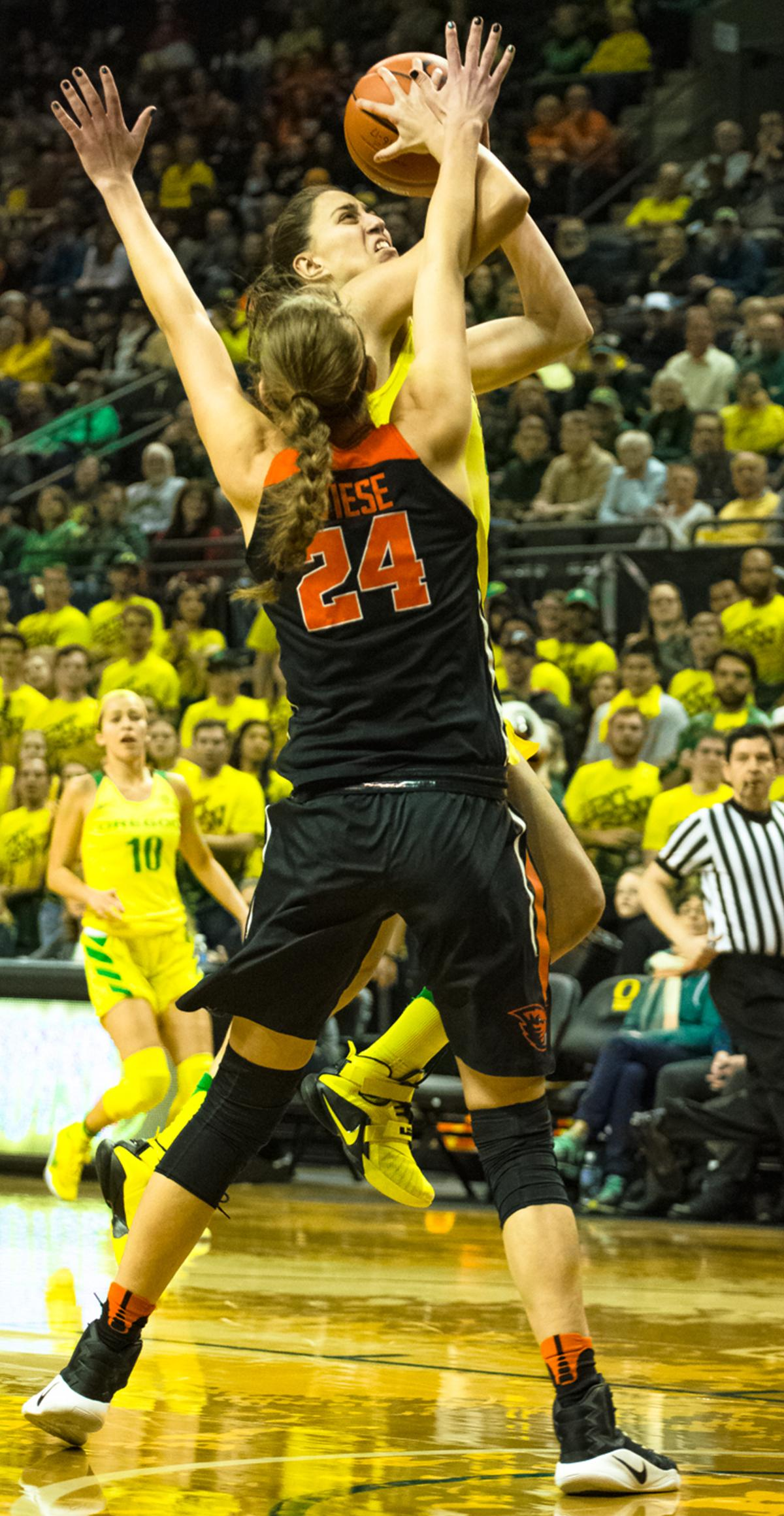 Oregon Ducks Guard Maite Cazorla (#5) goes up for a layup against Oregon State Guard Sydney Wiese (#24). Oregon Ducks lost 40-43 to Oregon State Beavers in a tightly matched fourth quarter. Photo by Jonathan Booker, Oregon News Lab