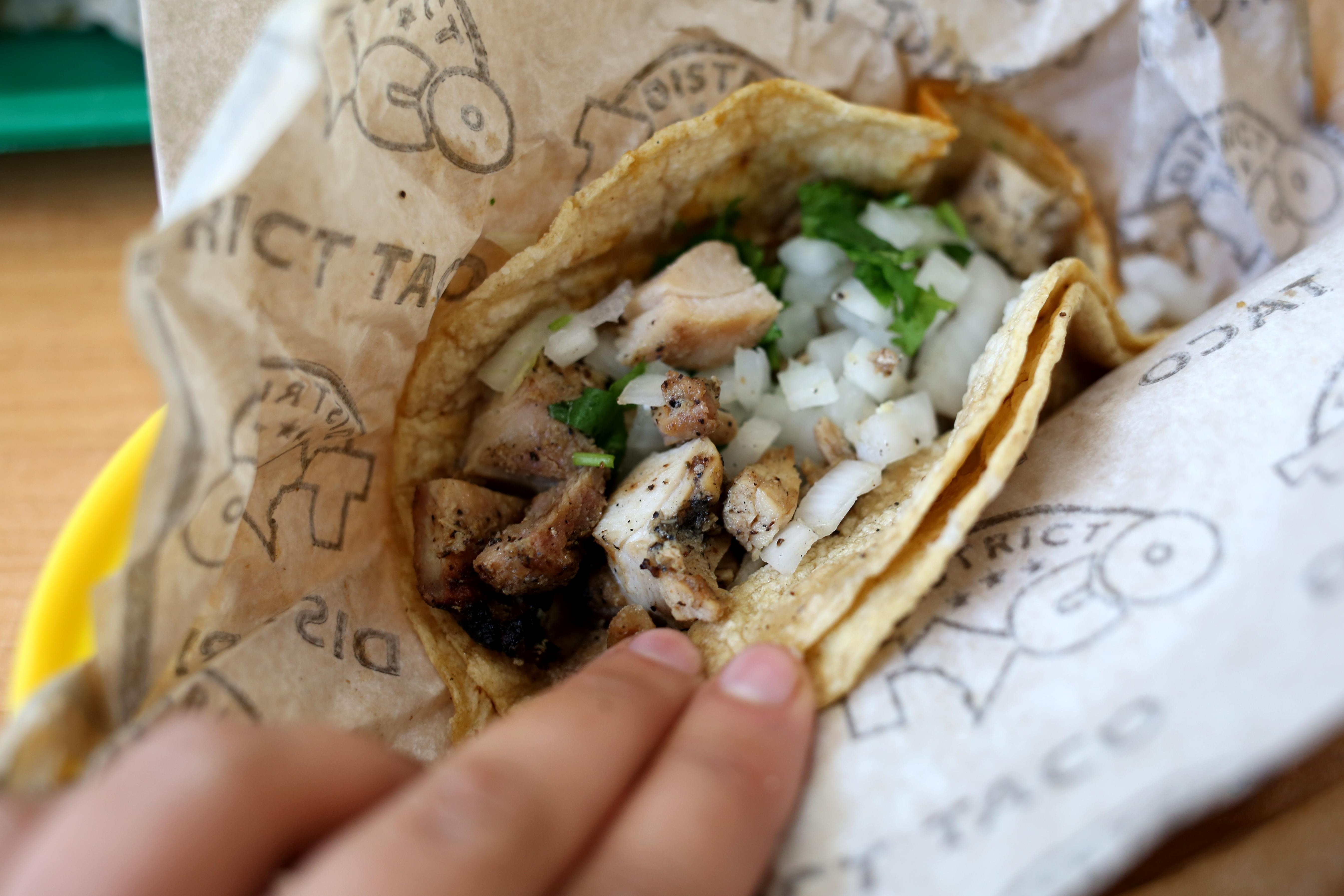 I liked that there was dark meat in the chicken taco - it was flavorful, but some parts were so overcooked and dry that the texture was closer to jerky. (Amanda Andrade-Rhoades/DC Refined)