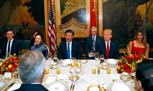 President Donald Trump and Chinese President Xi Jinping, with their wives, first lady Melania Trump and Chinese first lady Peng Liyuan are seated during a dinner at Mar-a-Lago, Thursday, April 6, 2017, in Palm Beach, Fla. White House senior adviser Jared Kushner is seated at left. (AP Photo/Alex Brandon)