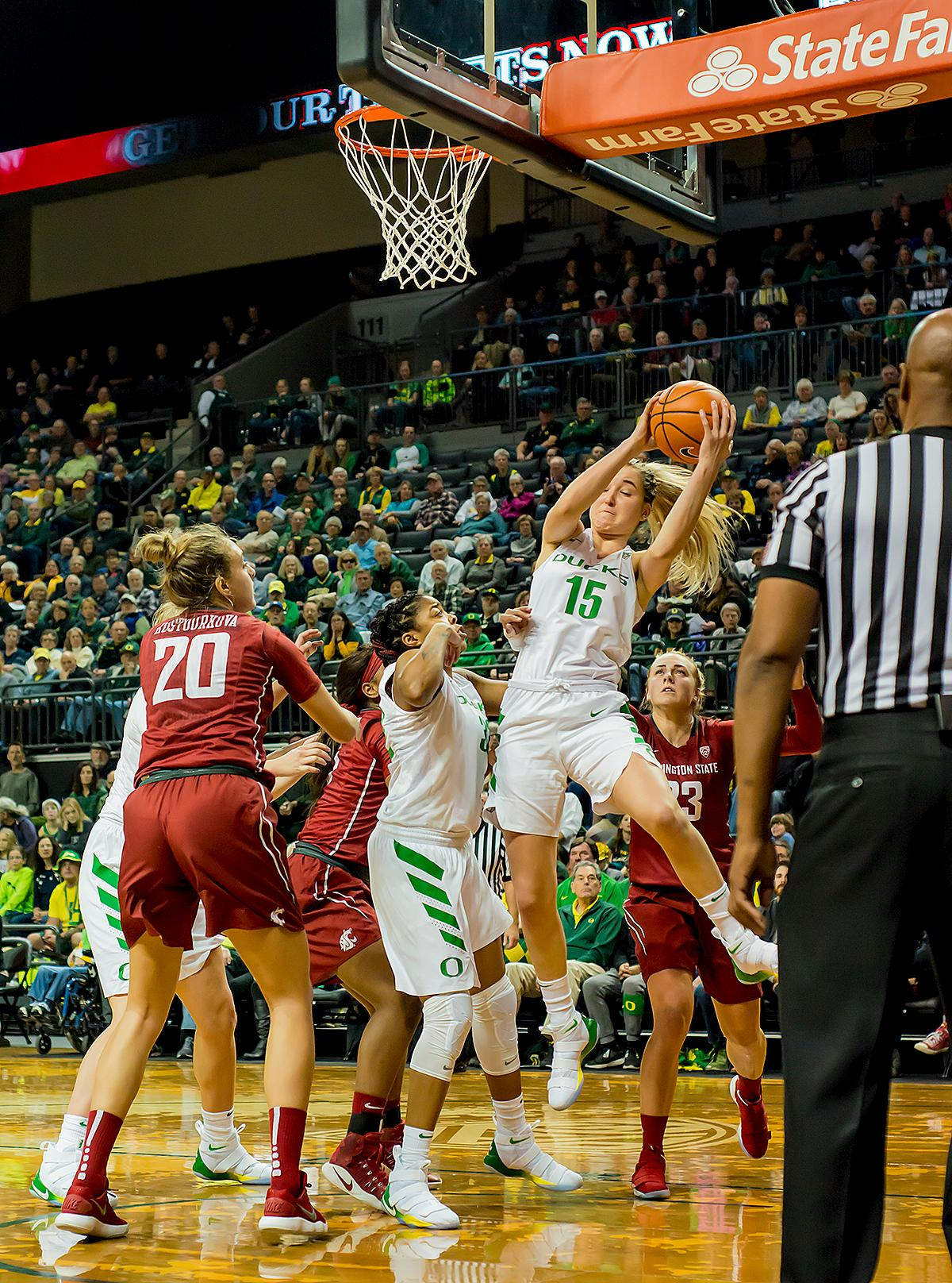 Oregon Ducks Anneli Maley (#15) comes down with a rebound. In their first conference basketball game of the season, the Oregon Women Ducks defeated the Washington State Cougars 89-56 in Matt Knight Arena Saturday afternoon. Oregon's Ruthy Hebard ran up 25 points with 10 rebounds. Sabrina Ionescu shot 25 points with five three-pointers and three rebounds. Lexi Bando added 18 points, with four three-pointers and pulled down three rebounds. Satou Sabally ended the game with 14 points with one three-pointer and two rebounds. The Ducks are now 12-2 overall with 1-0 in conference and the Cougars stand at 7-6 overall and 0-1 in conference play. The Oregon Women Ducks next play the University of Washington Huskies at 1:00 pm on Sunday. Photo by Karly DeWees, Oregon News Lab