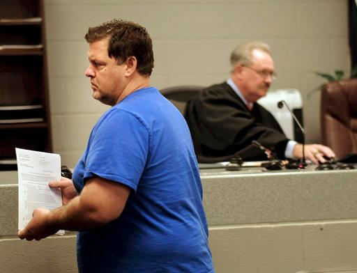 Todd Kohlhepp appears in a Spartanburg County magistrate courtroom, Friday, Nov. 4, 2016, in Spartanburg, S.C.. Kohlhepp, a 45-year-old registered sex offender with a previous kidnapping conviction, appeared at a bond hearing Friday on a kidnapping charge in connection to a woman being found chained inside a storage container on a property in Woodruff, S.C. More charges will be filed later, the prosecutor told the court.  (Tim Kimzey/The Spartanburg Herald-Journal via AP)