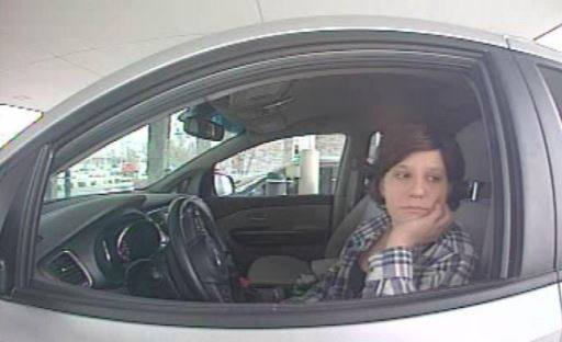Logan Police are seeking a suspect in a string of vehicle burglaries from Dec. 9. The woman in this photo is alleged to be cashing checks and using a victim's identity from the car break-ins. (Photo: Logan Police)<p></p>