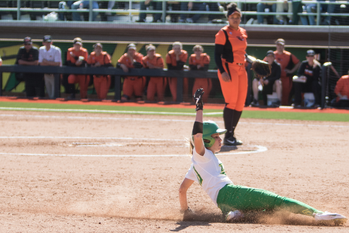 Oregon Ducks left fielder Alexis Mack slides in safe to third base.  The Oregon Ducks defeated the Oregon State Beavers seven to zero on Sunday, April 30, 2017. The Ducks' victory marked the third victory of the three game sweep against the Beavers. Photo by Austin Hicks, Oregon News Lab