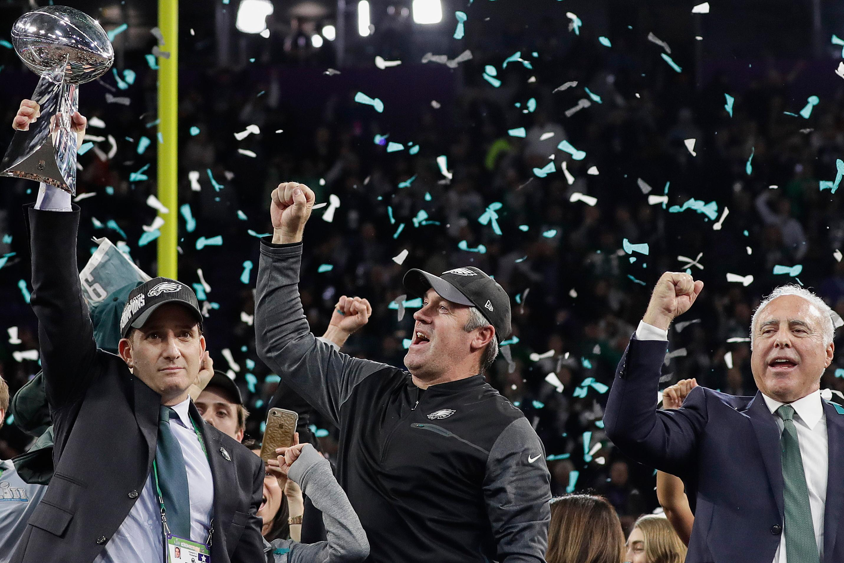 Philadelphia Eagles general manager Howie Roseman, left, holds up the Vince Lombardi Trophy as he celebrates with head coach Doug Pederson, center, and owner Jeffrey Lurie after the NFL Super Bowl 52 football game against the New England Patriots, Sunday, Feb. 4, 2018, in Minneapolis. The Eagles won 41-33. (AP Photo/Matt Slocum)