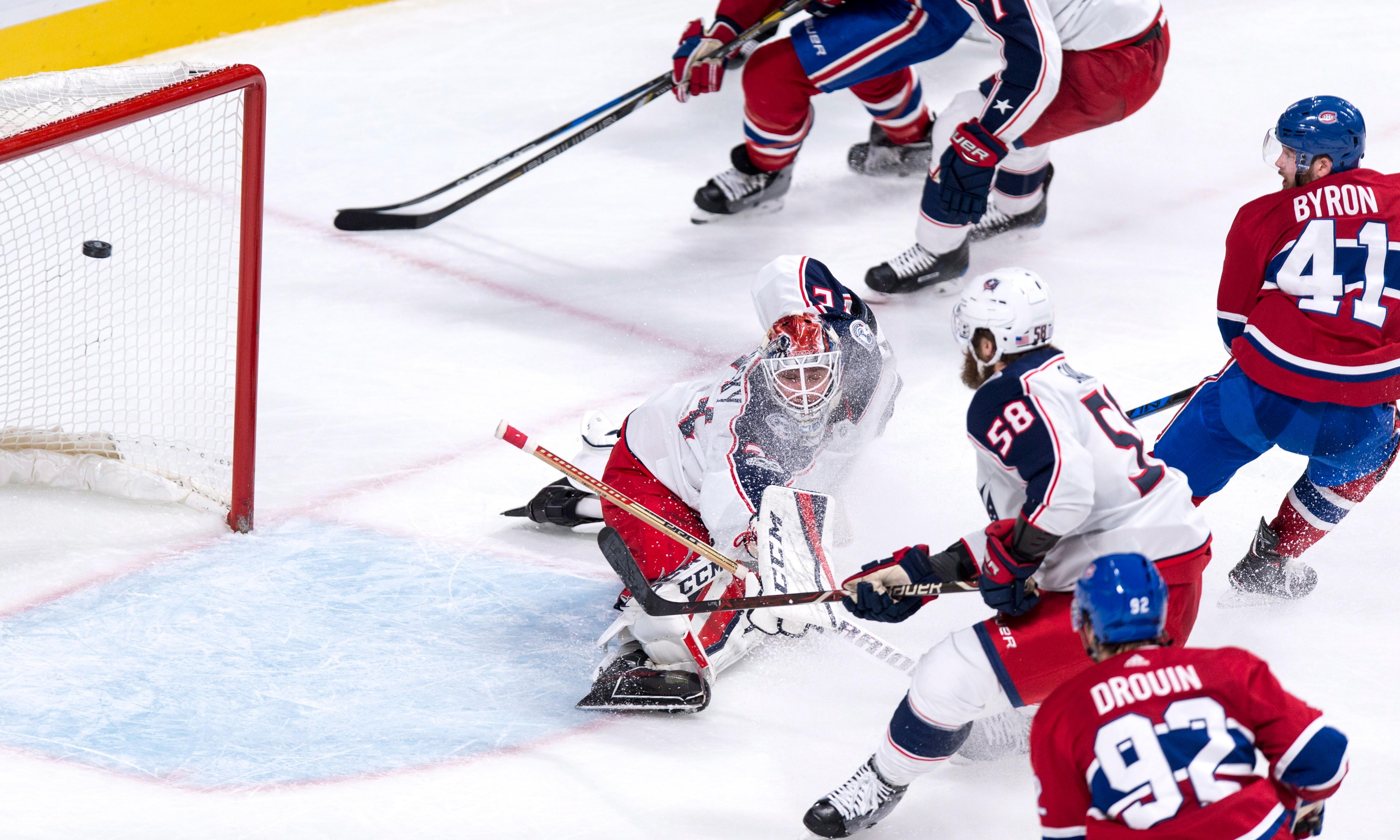 Montreal Canadiens' Paul Byron, upper right, scores past Columbus Blue Jackets goalie Sergei Bobrovsky during the third period of an NHL hockey game Tuesday, Nov. 14, 2017, in Montreal. (Paul Chiasson/The Canadian Press via AP)
