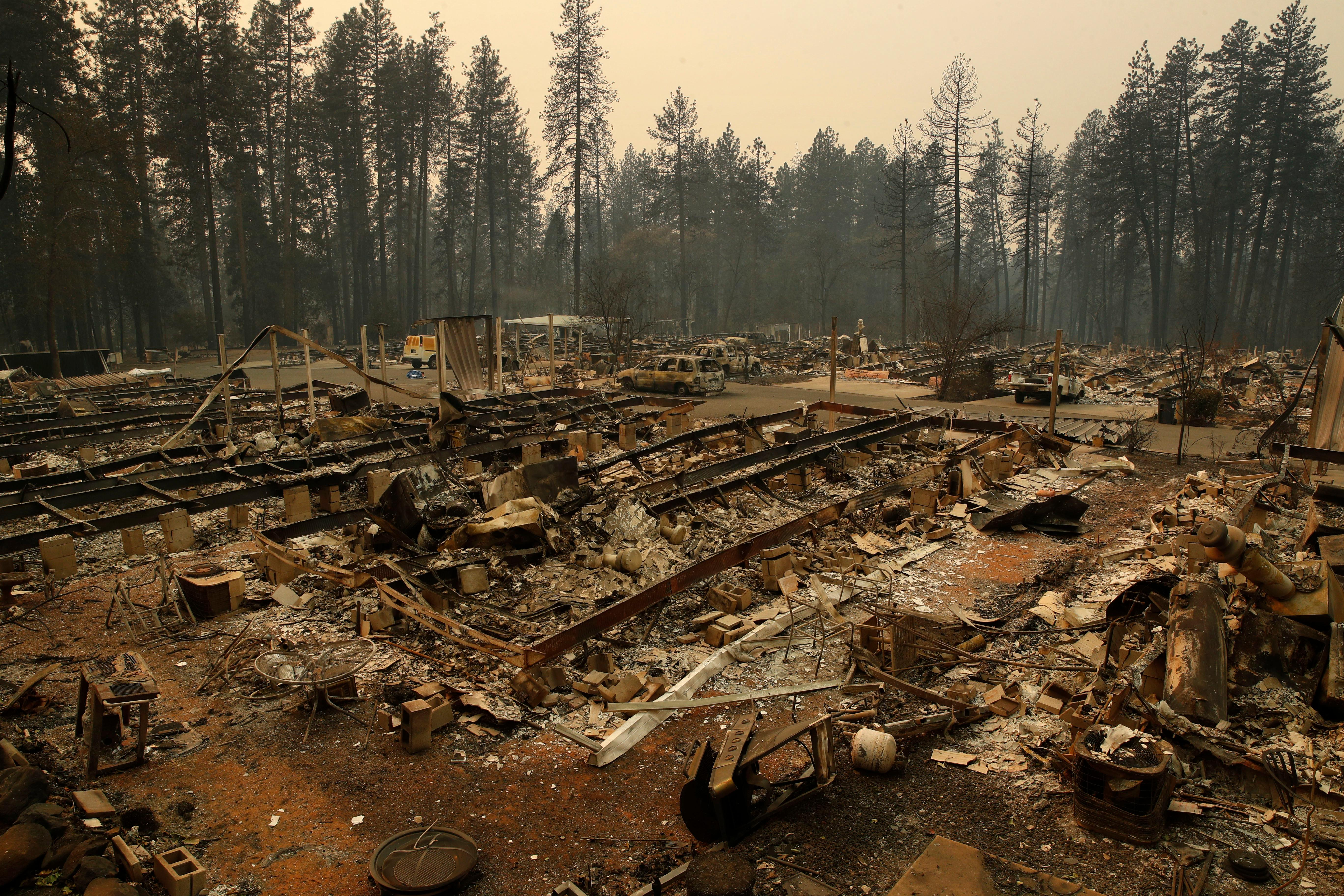 Rubble remains where mobile homes once stood at the Camp Fire, Monday, Nov. 12, 2018, in Paradise, Calif. (AP Photo/John Locher)