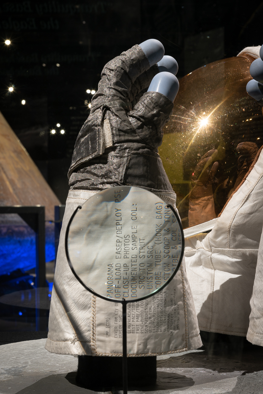 A magnifying glass reveals the fine text stitched into Aldrin's moon gauntlet. / Image: Phil Armstrong, Cincinnati Refined // Published: 10.2.19