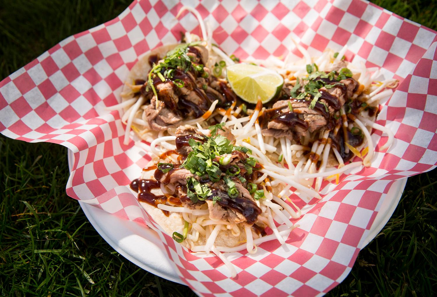 The Pho Tacos - Three street-sized corn tortillas topped with bean sprouts, Asian beef, pho sauce, green onion, cilantro with a lime wedge at the Peasant Food Manifesto truck. Owner Beth Clement began the food truck over four years ago and served up Pho Tacos as a joke - but it was a joke that stuck around because people absolutely craved them. Also, after being frustrated with her experiences ordering out pho, she decided on the Pho French Dip, which in her opinion is the best way to eat pho-to-go. If you are craving these fusion foods, you can find her truck on the brewery circuit at locations such as Obec, Populuxe, Reubens, Broadview, and Ounces. Check out her website to see where she's at! (Sy Bean / Seattle Refined)