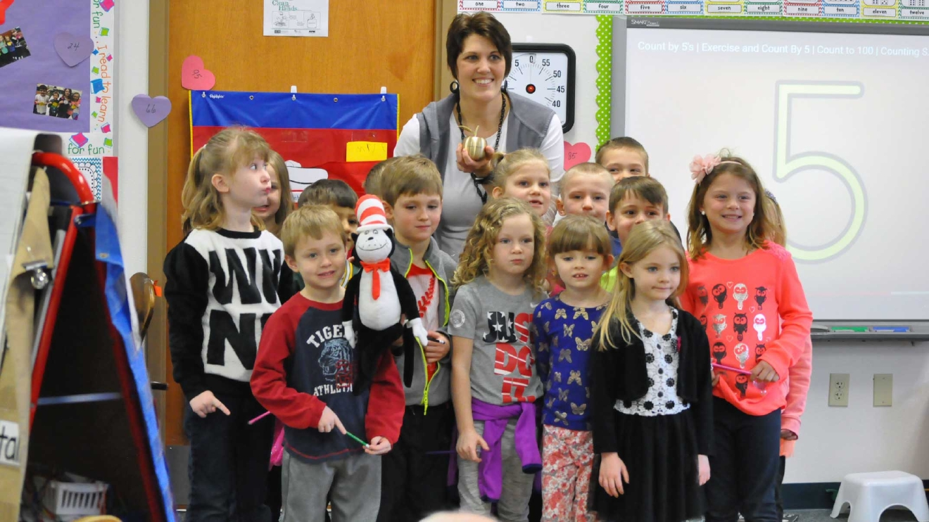Kendra Wetzel poses with students at Lannoye Elementary School in Pulaski March 8, 2017, in honor of her Golden Apple Award. (WLUK/Donna Fischer)
